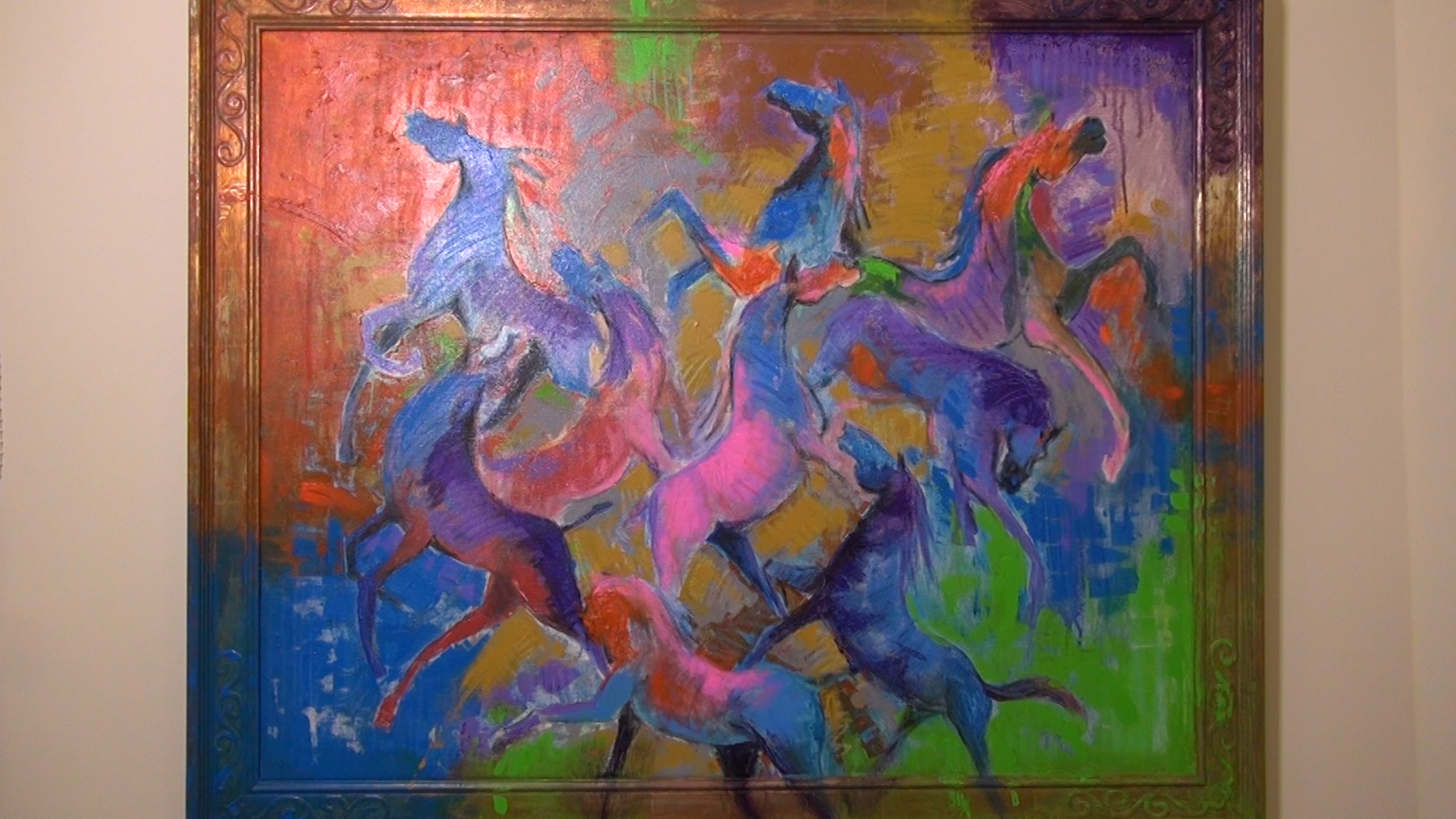 Ahmad Alkarkhi has started painting with a whole new color palette since he came to the U.S. These colorful horses represent refugees who come from all over and work and live together.