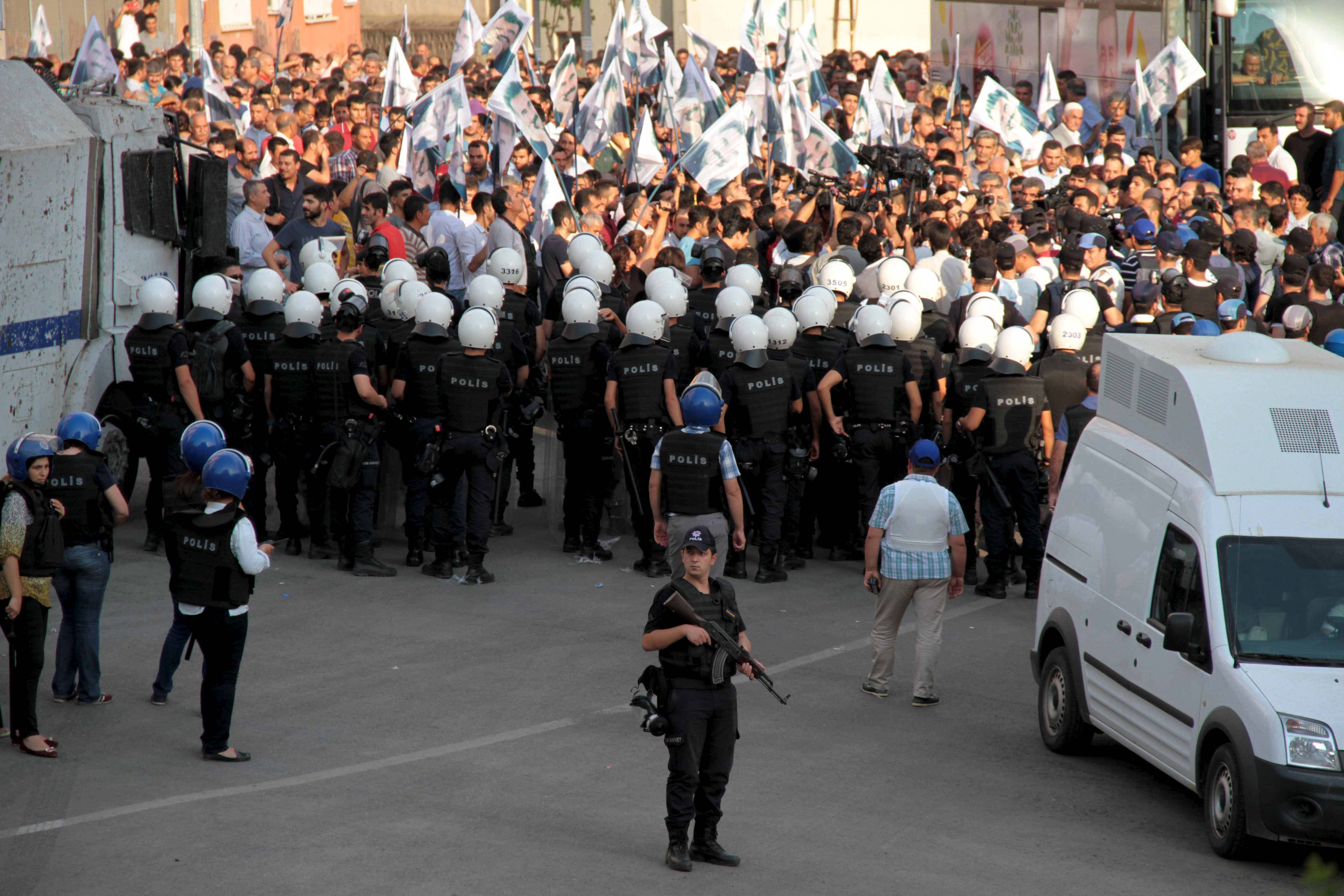 Turkish riot police surround demonstrators during a protest against the latest security operations in Diyarbakir, Turkey, September 6, 2015. Two policeman were killed and three others injured in predominantly Kurdish eastern Turkey's largest city whe...