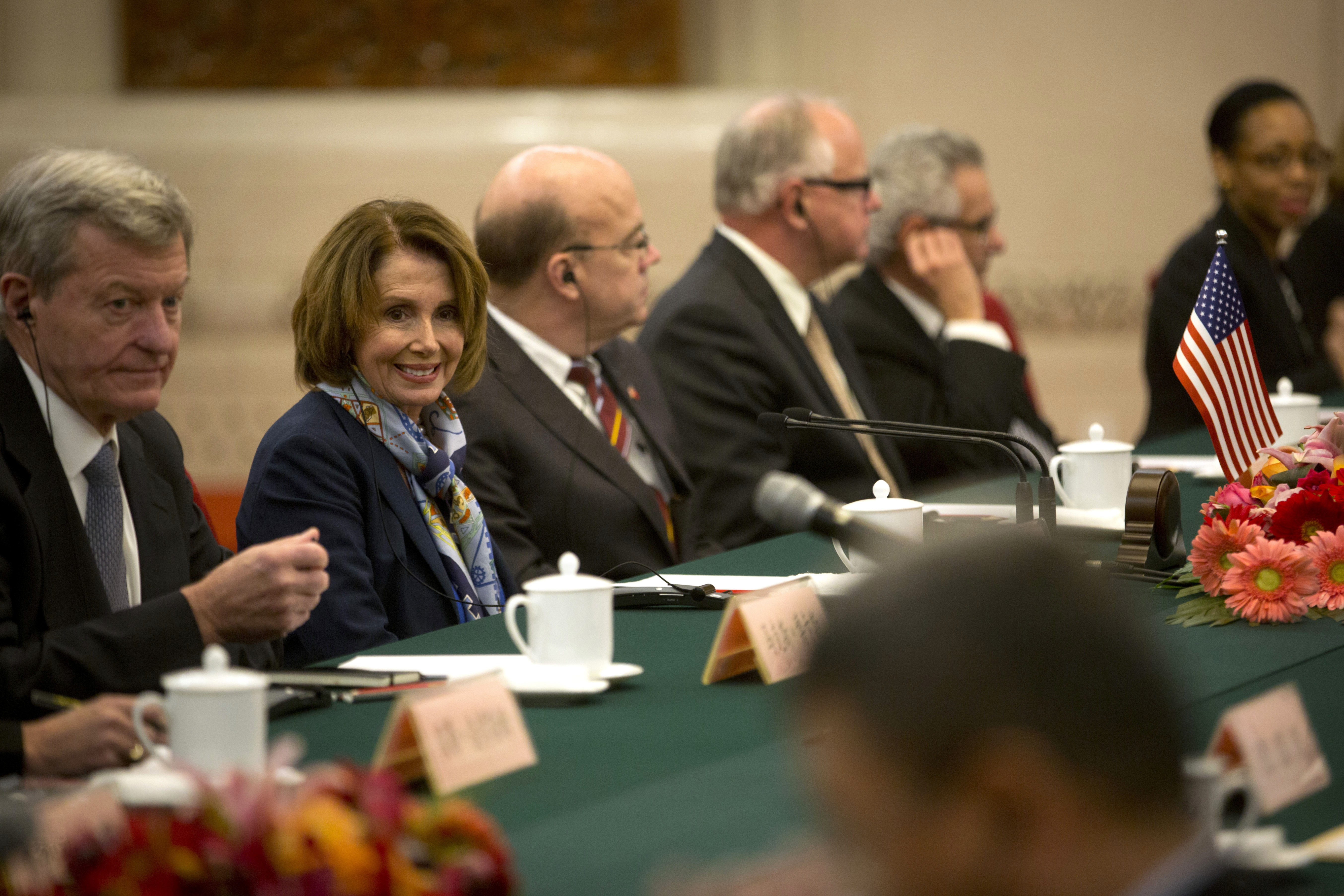 U.S. House Minority Leader Nancy Pelosi of Calif., second from left, smiles during a bilateral meeting with Zhang Ping, vice chairman of China's National People's Congress, at the Great Hall of the People in Beijing, Nov. 12, 2015.