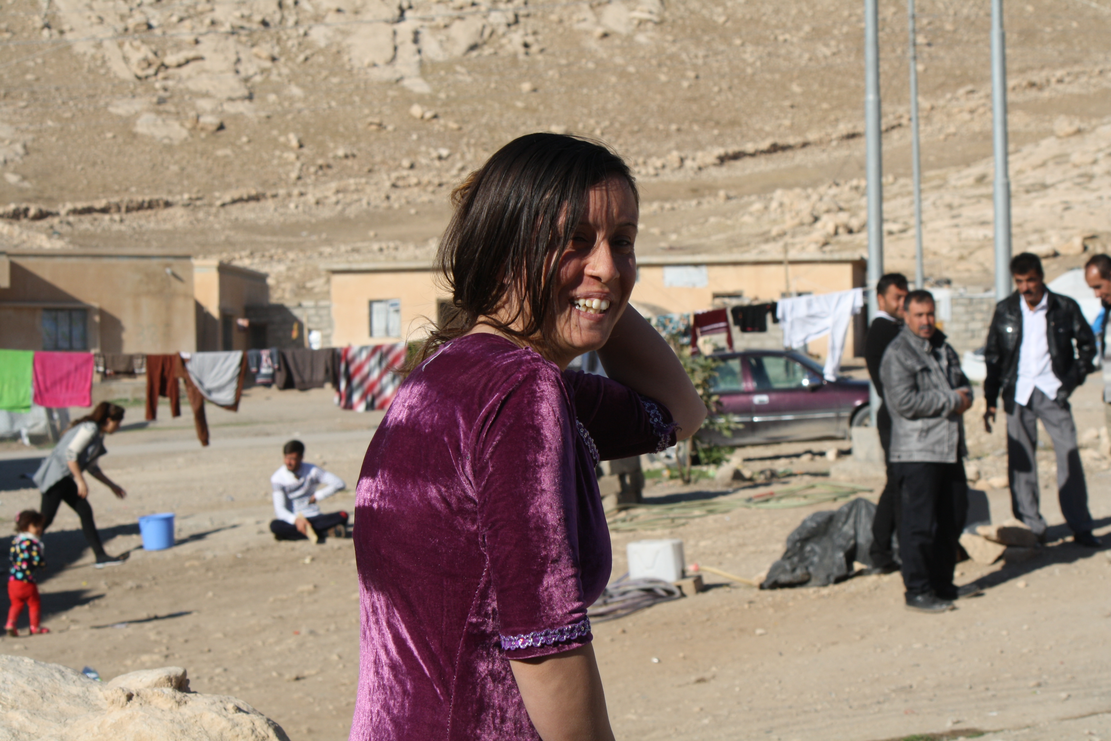 Khalifa, after telling VOA about her year in Islamic State captivity, hurries off to visit with friends and family on Nov. 25, 2016, near Dohuk, Kurdistan, Iraq. (H. Murdock/VOA)