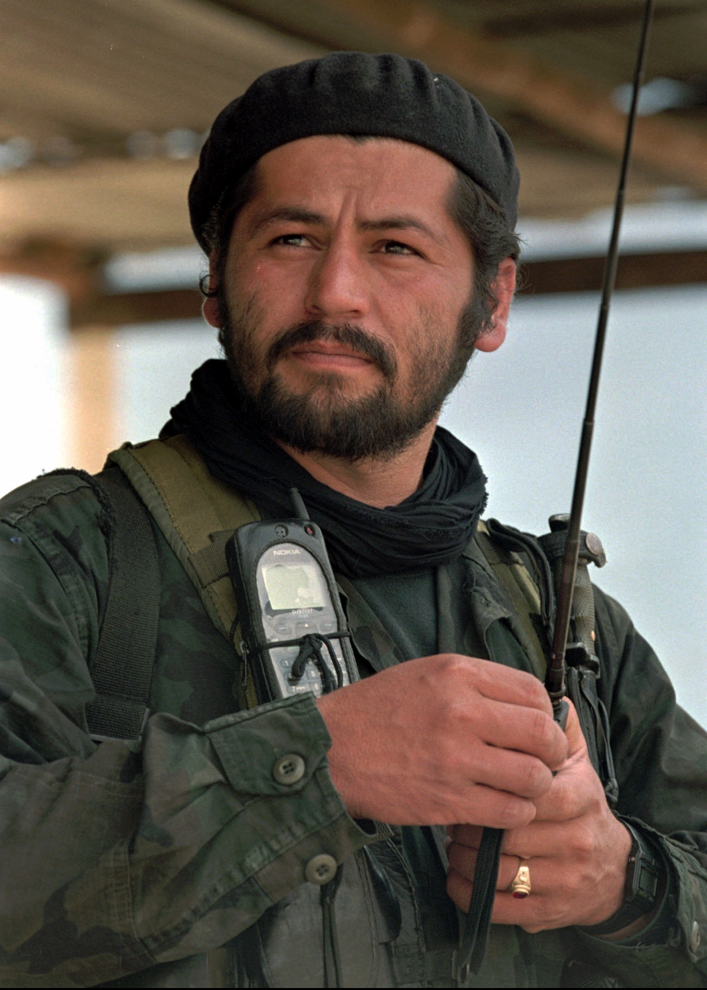 FILE - Henry Castellanos, also known as Romana, a senior commander of the Revolutionary Armed Forces of Colombia, talks on the radio in El Calvario, Colombia, March 27, 1998. Authorities said Friday that Castellanos and another former rebel leader ha...