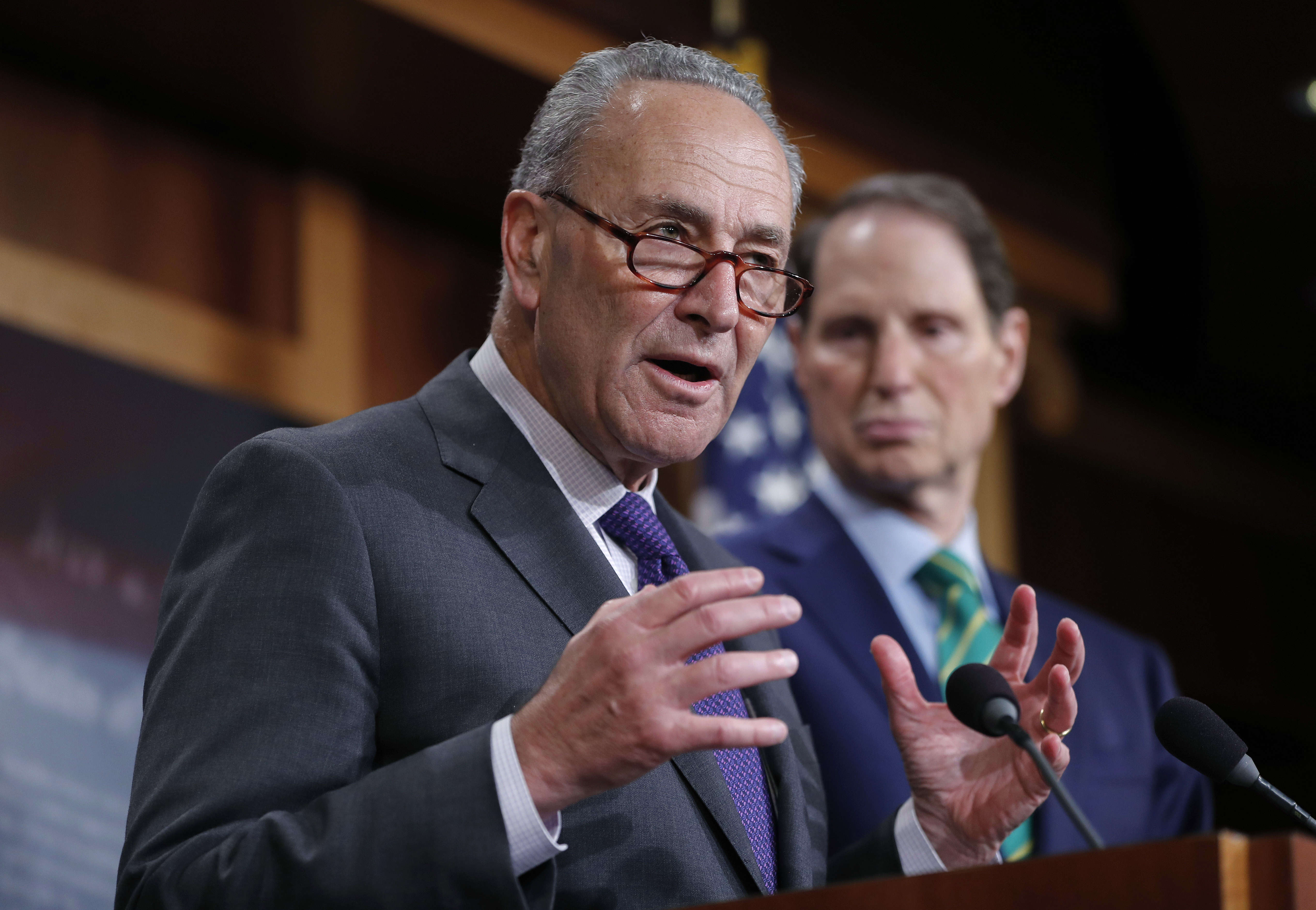 Senate Minority Leader Chuck Schumer of New York and Sen. Ron Wyden, D-Ore., discuss the Republican tax plan during a news conference on Capitol Hill in Washington, Sept. 27, 2017.