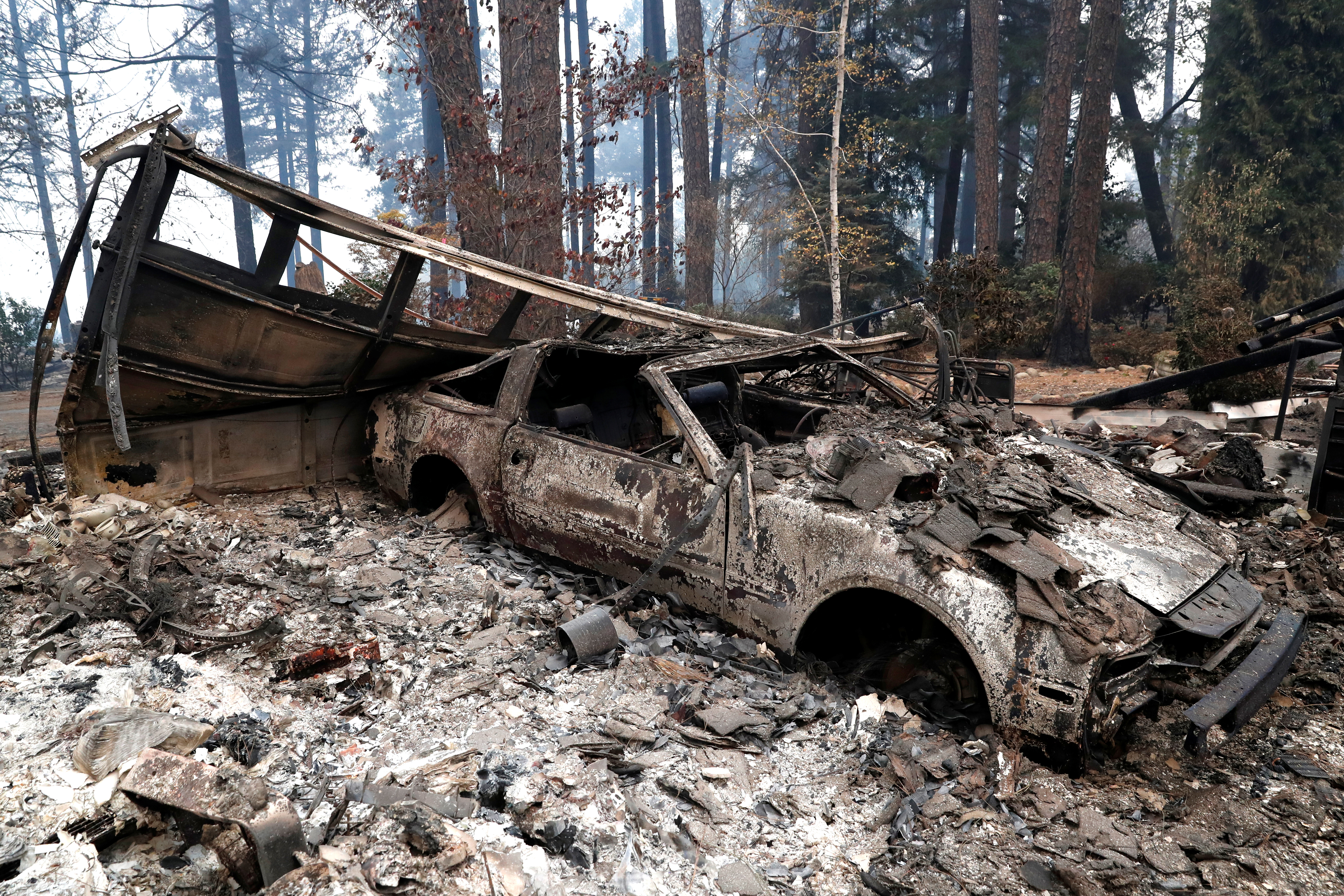 A car destroyed by the Camp Fire is seen in Paradise, California, Nov. 13, 2018.