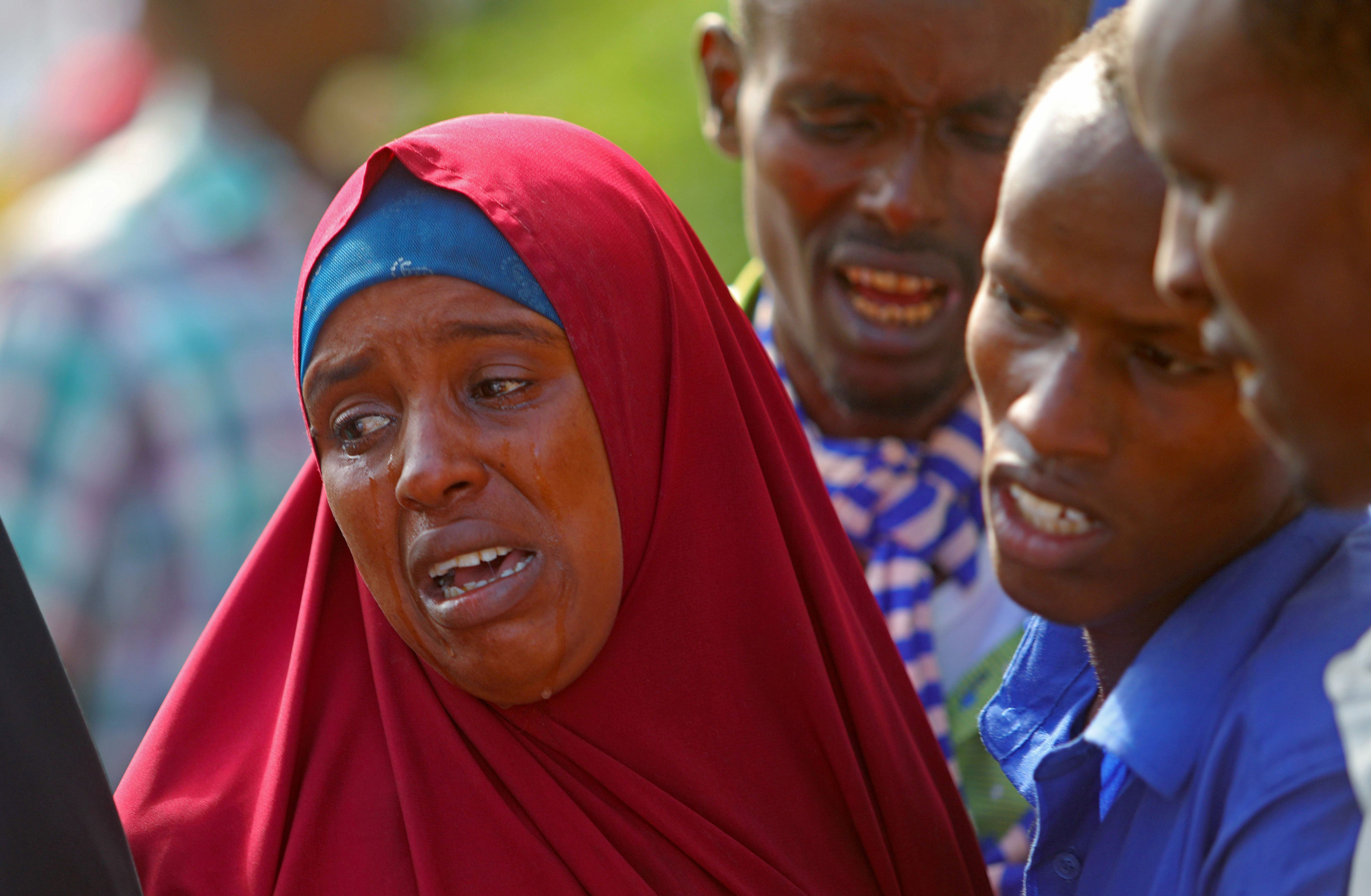 Relatives mourn the killing of their kin in an attack by Somali forces supported by U.S. troops, at the Madina hospital in Mogadishu, Somalia, Aug. 25, 2017.