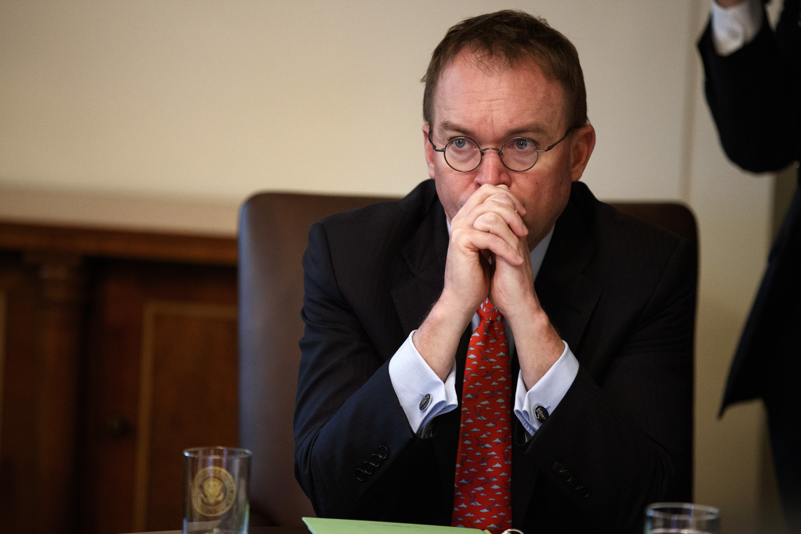 In this Jan. 2, 2019, file photo White House chief of staff Mick Mulvaney listens as President Donald Trump speaks during a cabinet meeting at the White House in Washington.
