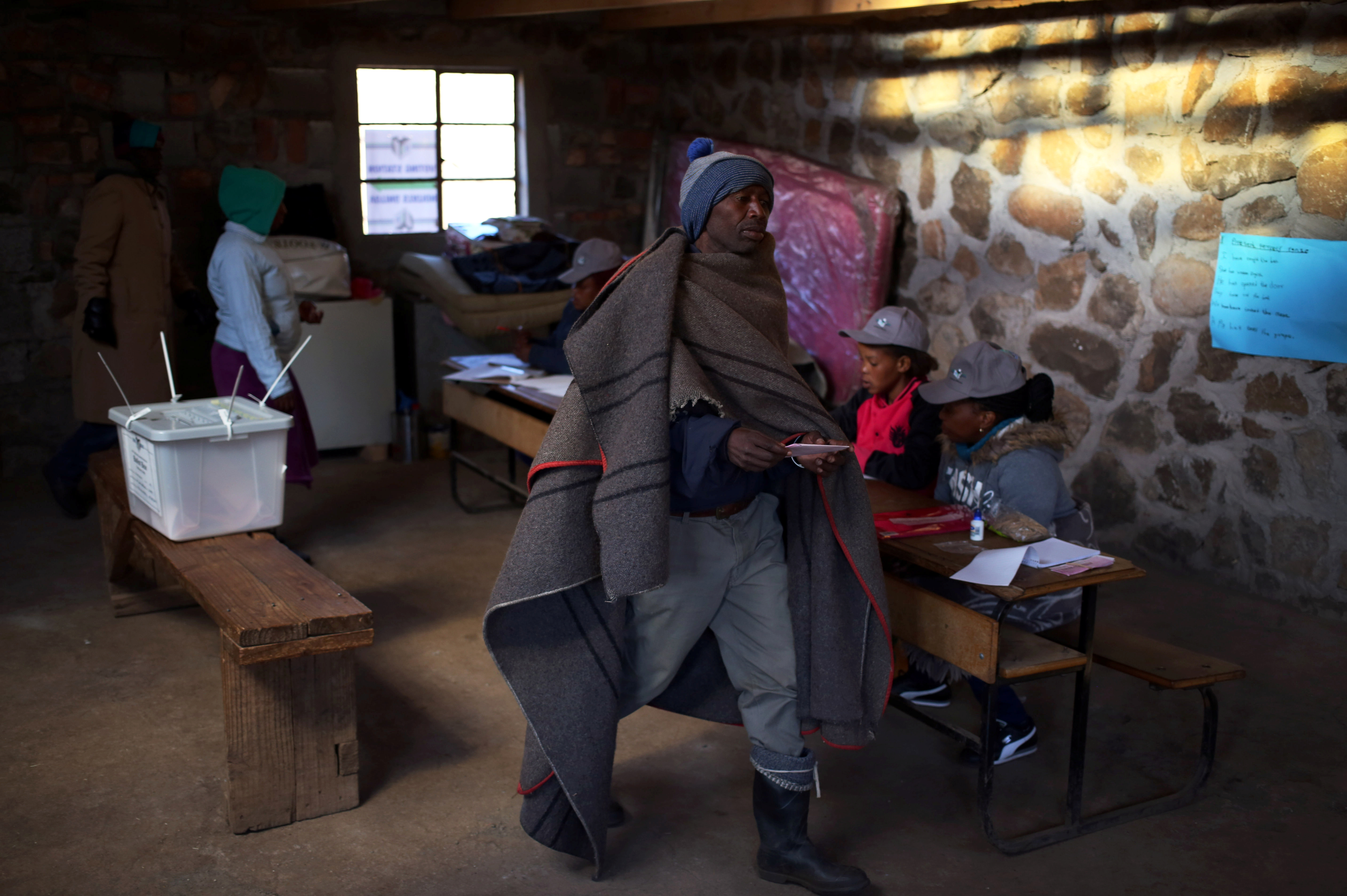 FILE - Locals arrive to cast their vote during the national elections at Semonkong, Lesotho, June 3, 2017.