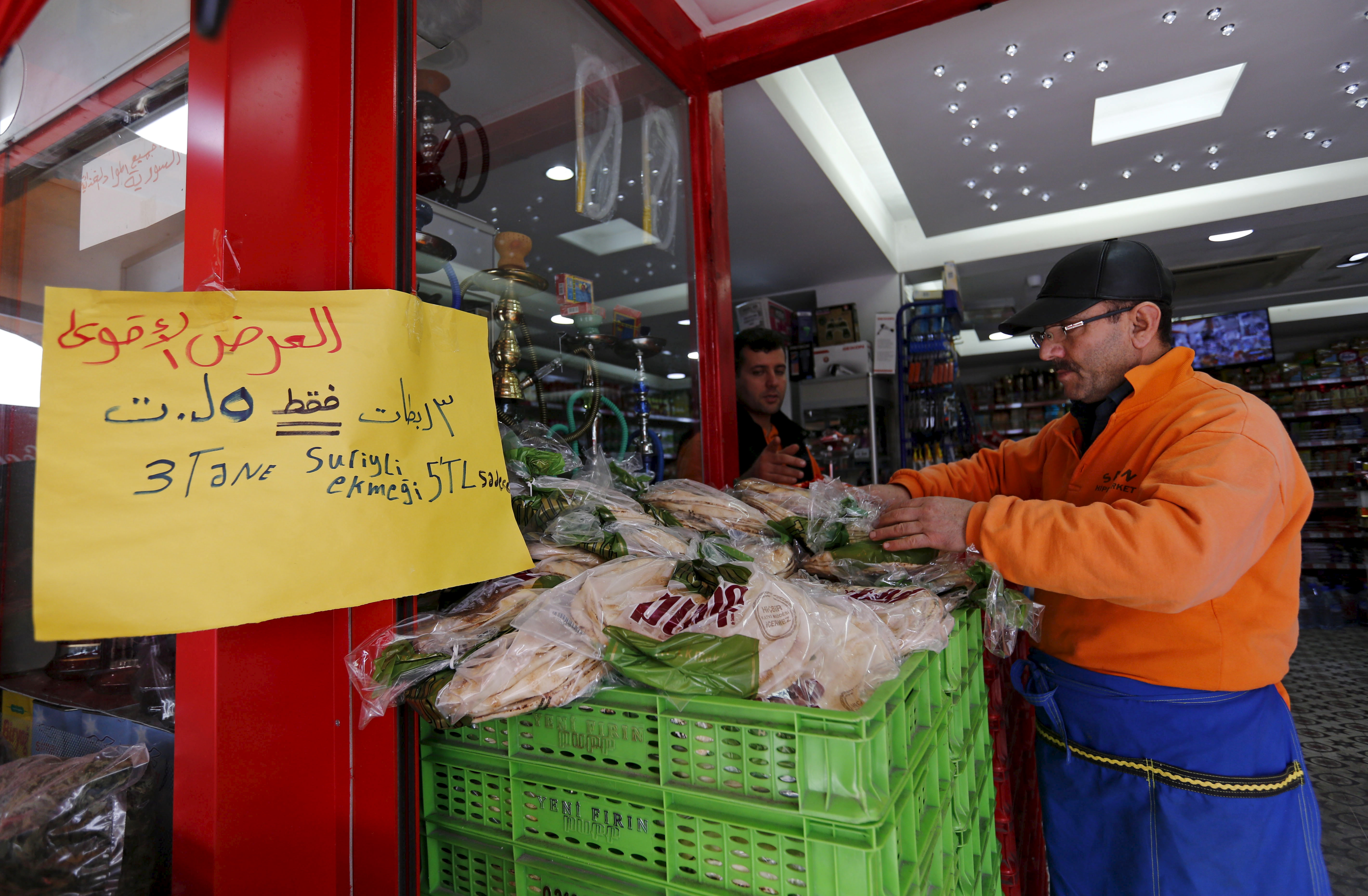 "An Arabic sign reads ""3 Syrian style bread 5 lira"" is seen at a market in Istanbul, Turkey, February 17, 2016."