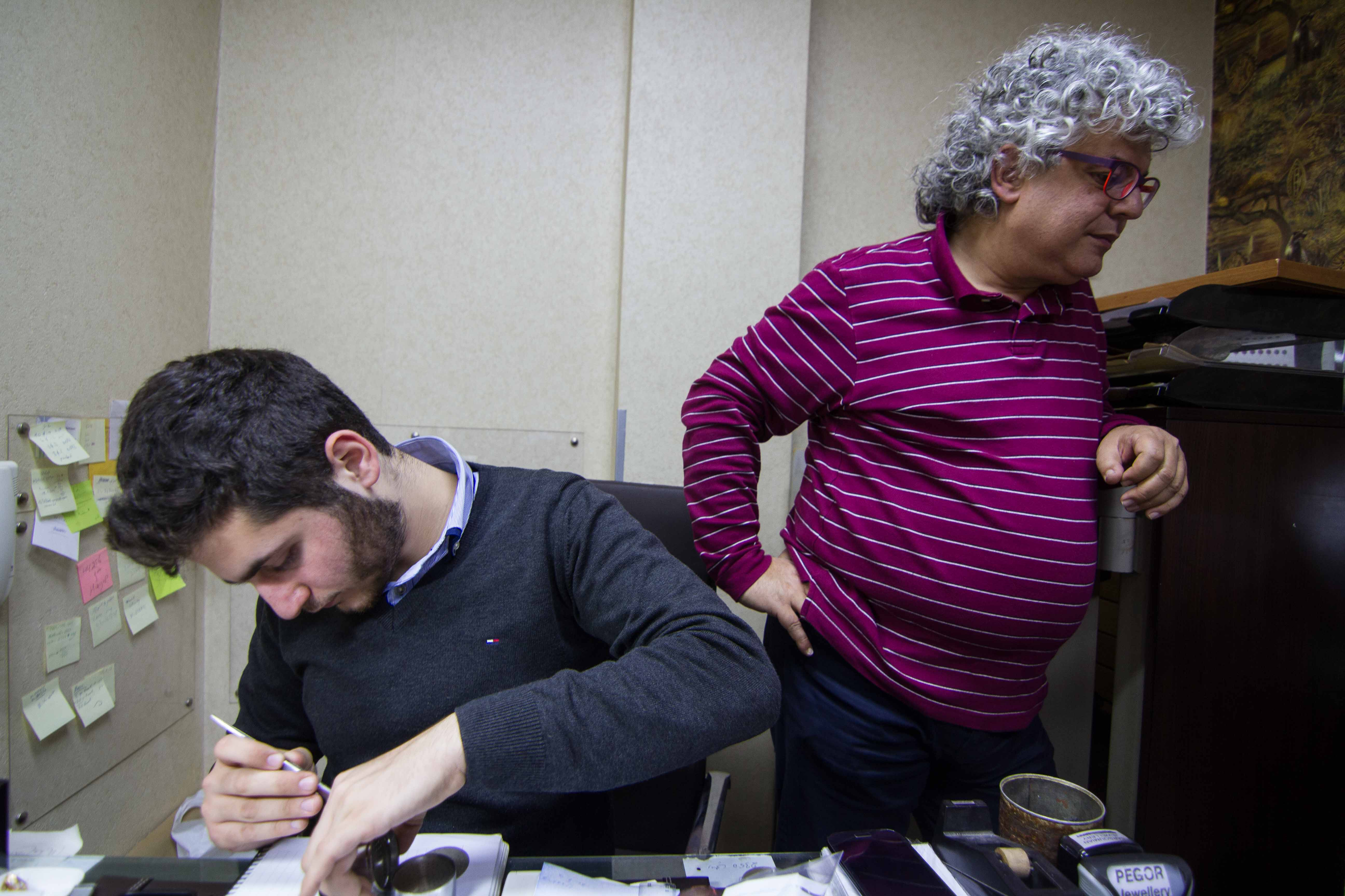 Khajag Barsoumian, left, and his father, Sarkis, work in the family business, in Beirut, Lebanon, Feb. 26, 2016. Unlike many of the younger Armenian generation, 19-year-old Khajag has decided to follow in his father's footsteps.