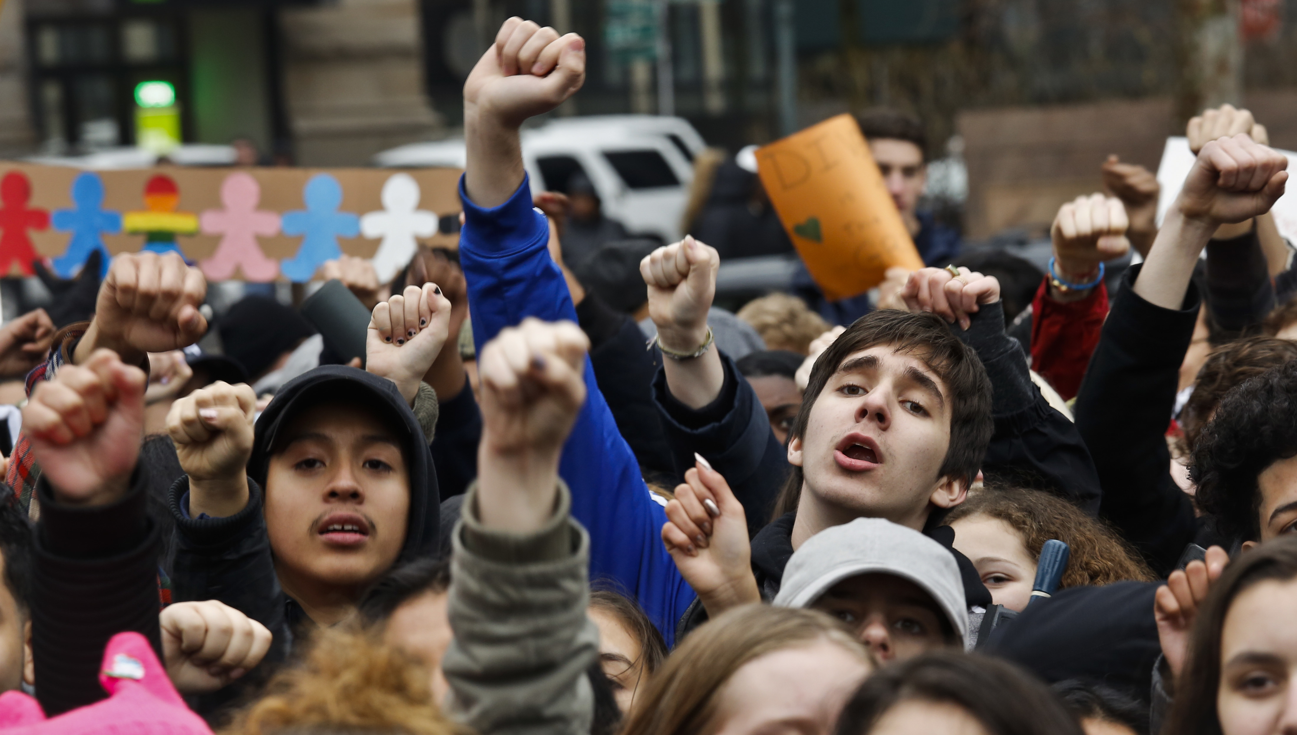 In New York's Foley Square, students from high schools and colleges protest with clenched fists, during a rally against President Donald Trump's executive order banning travel from seven Muslim-majority nations.