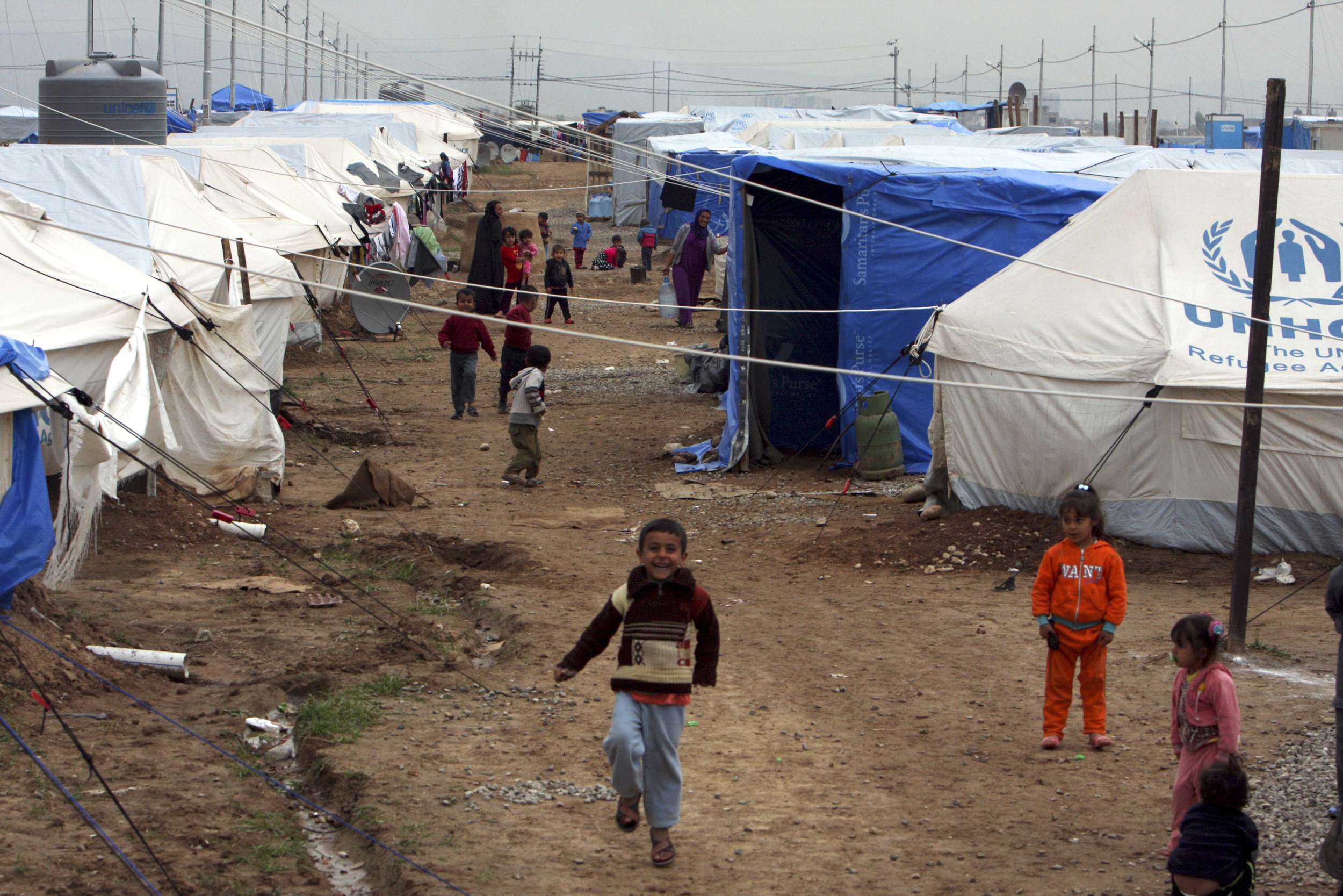 Displaced Iraqi children, who fled from Islamic State violence in Mosul, play in refugee camp on the outskirts of the Kurdish city of Irbil, December 1, 2014.