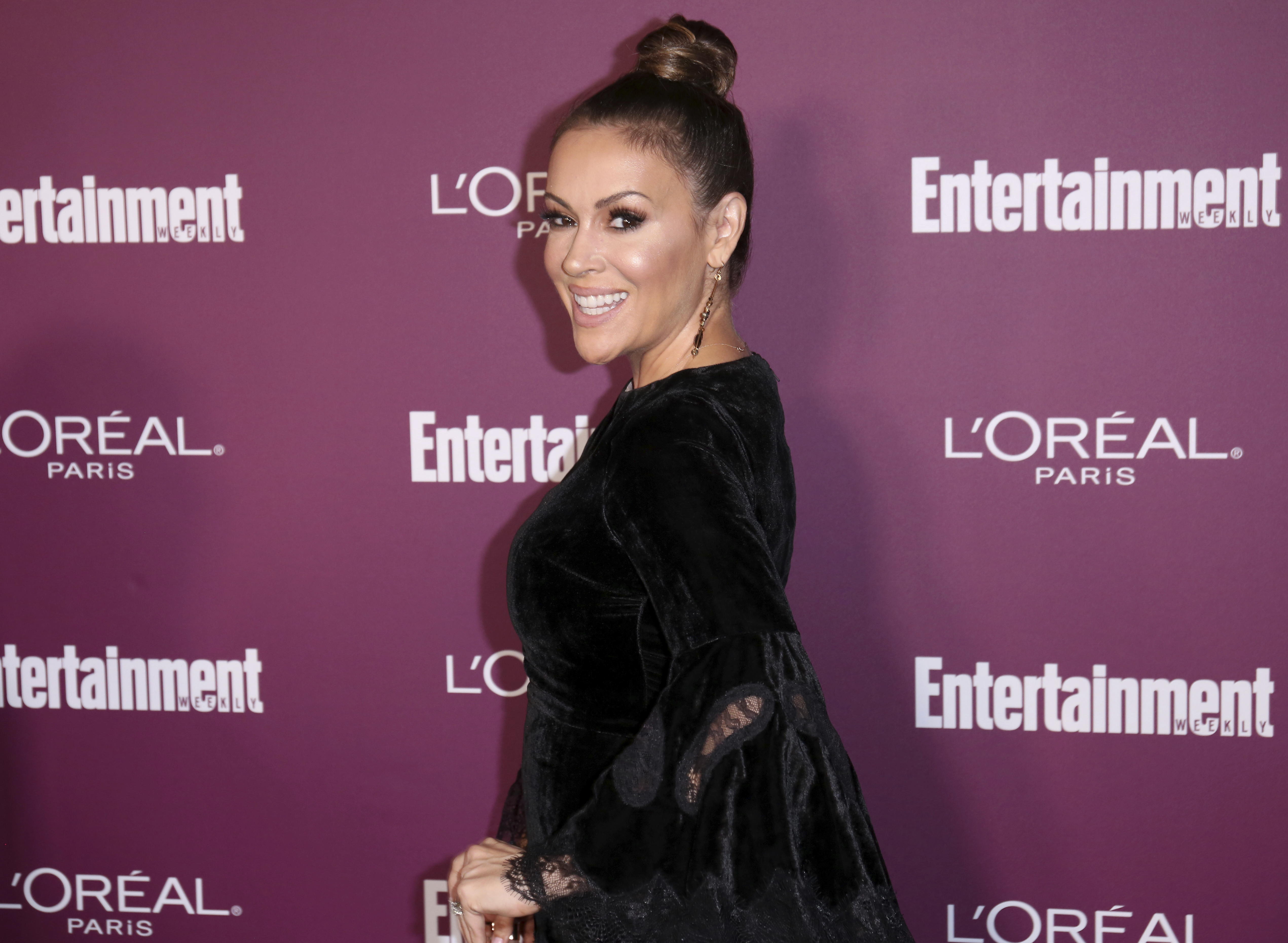 FILE - Alyssa Milano arrives at the 69th Primetime Emmy Awards Entertainment Weekly pre party at the Sunset Tower Hotel, Sept. 15, 2017, in Los Angeles.