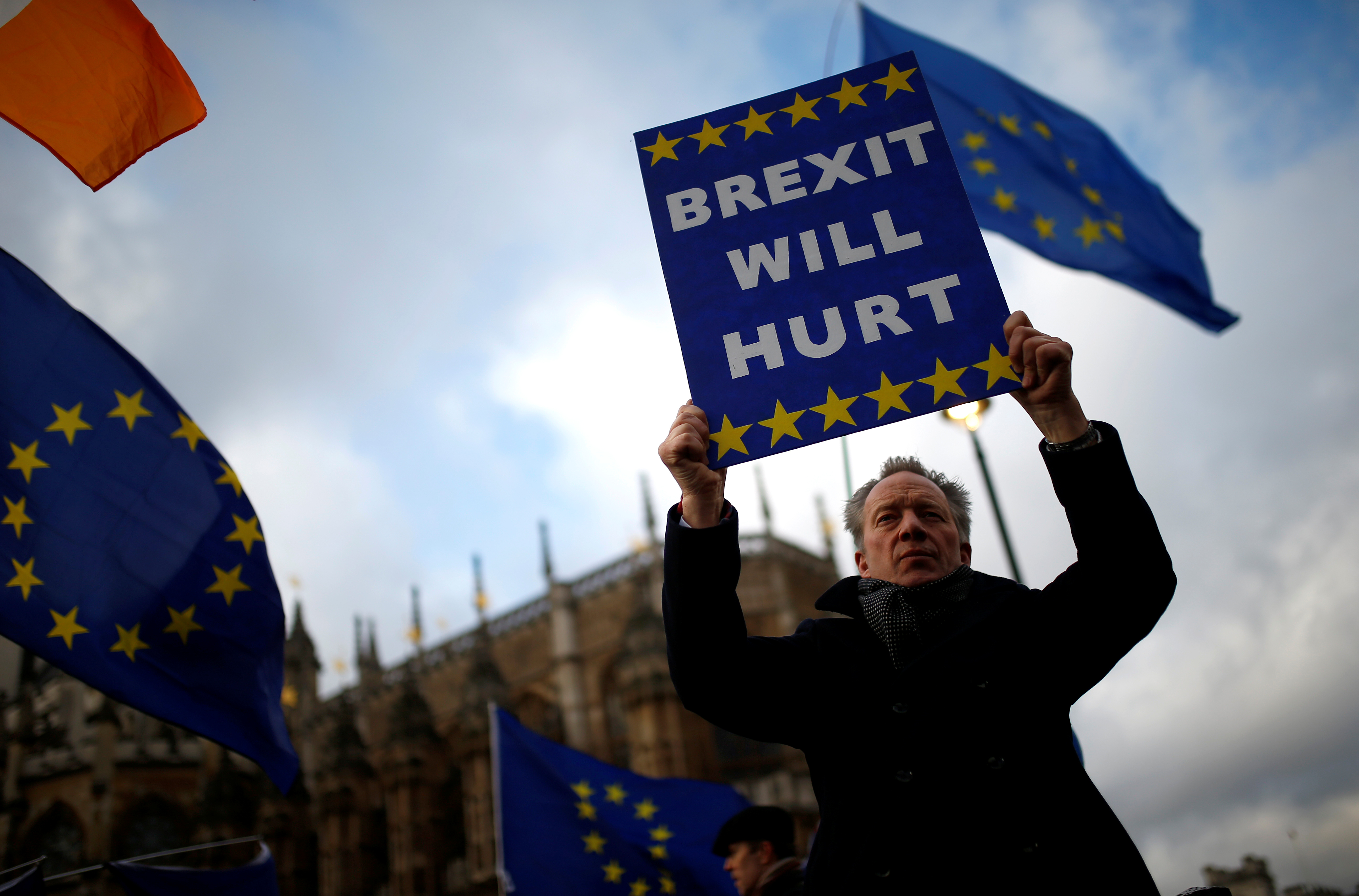 An anti-Brexit protester demonstrates outside the Houses of Parliament in London, Britain, March 12, 2019.