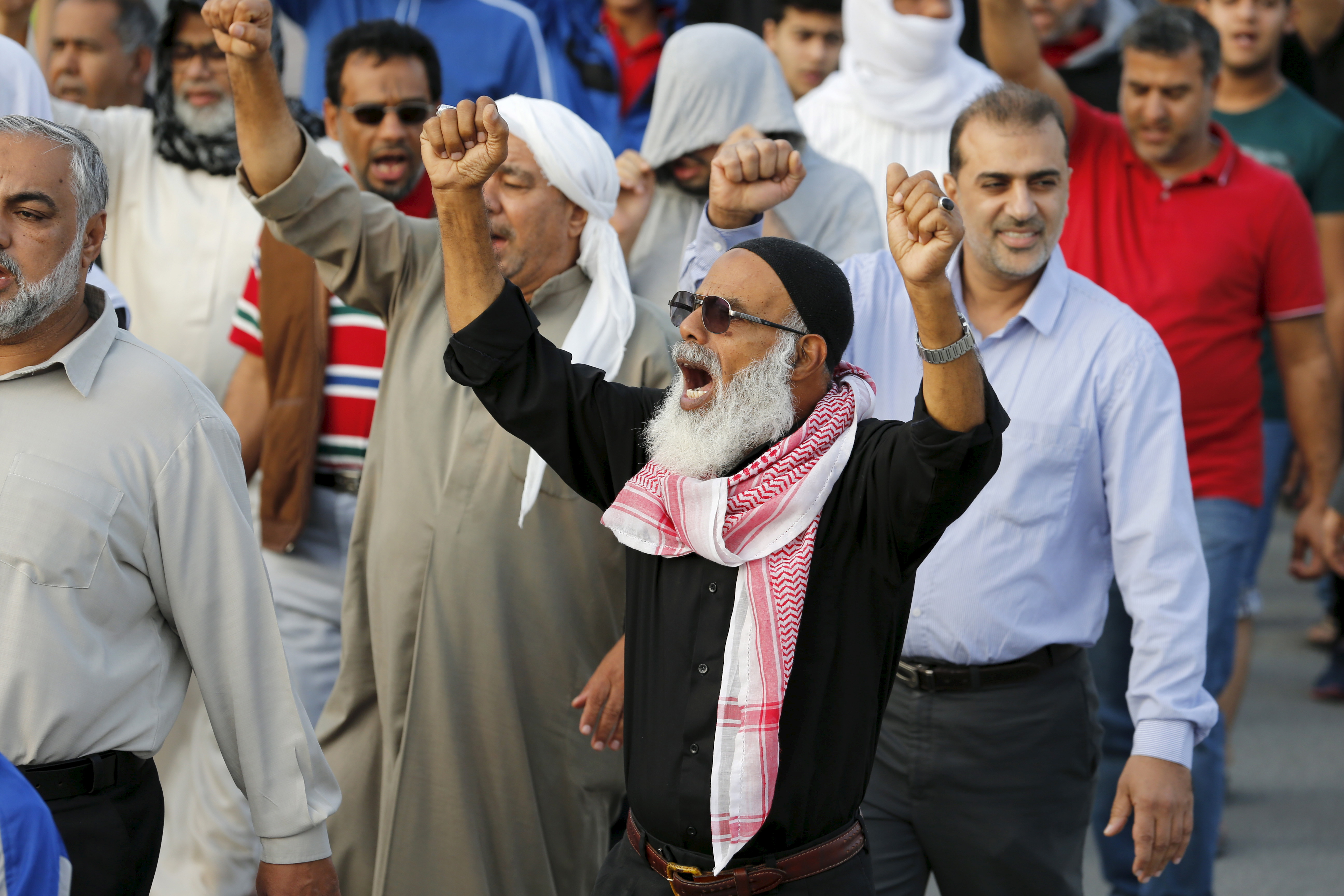 A man shouts anti-Saudi slogans as he takes part in a protest against the execution of Saudi Shi'ite cleric Nimr al-Nimr by Saudi authorities, in the village of Sanabis, west of Manama, Bahrain, Jan. 2, 2016.