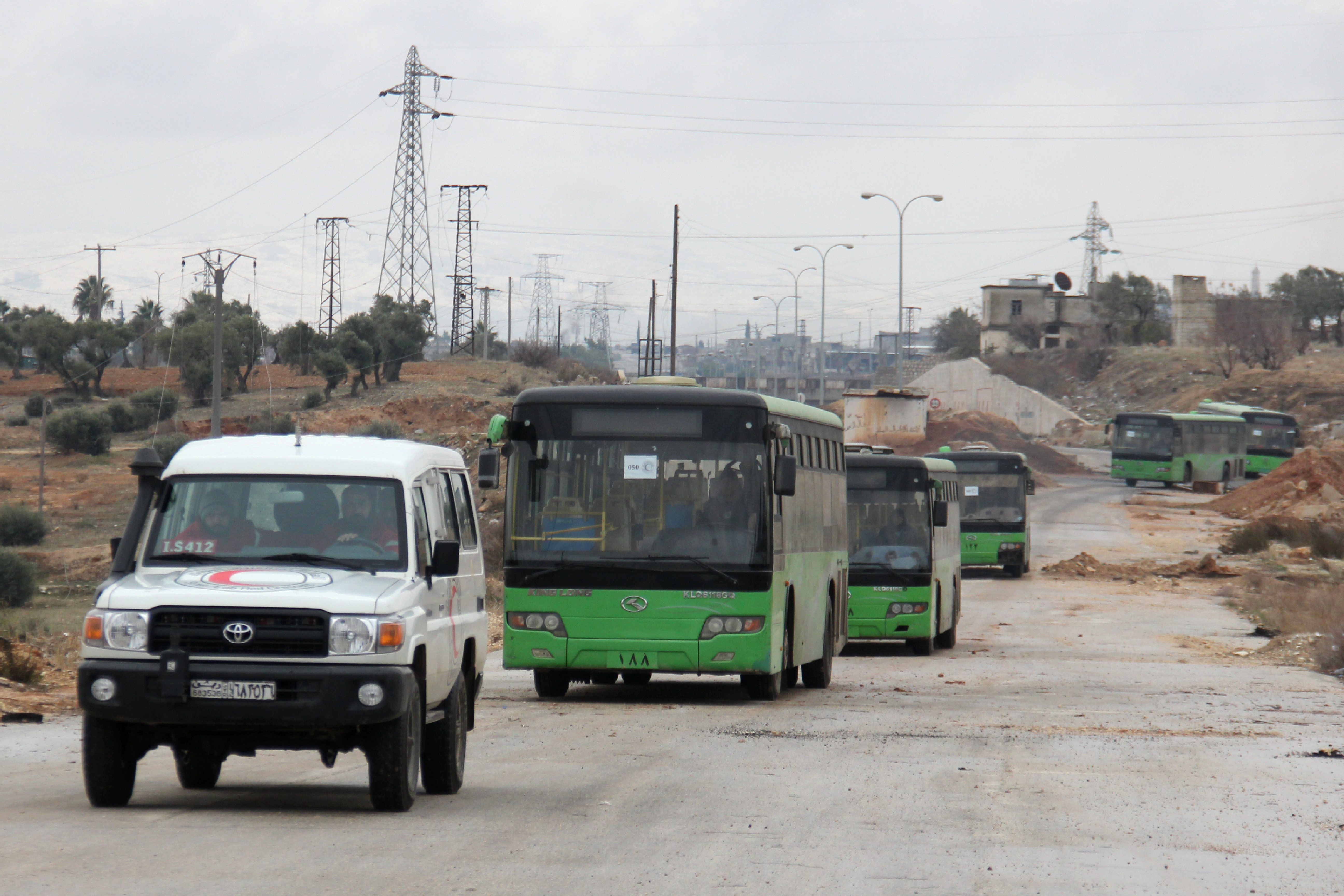 Buses sent to evacuate residents from al-Foua and Kafraya arrive at a rebel-held checkpoint on the outskirts of the two Syrian villages under rebel siege, Dec. 18, 2016.