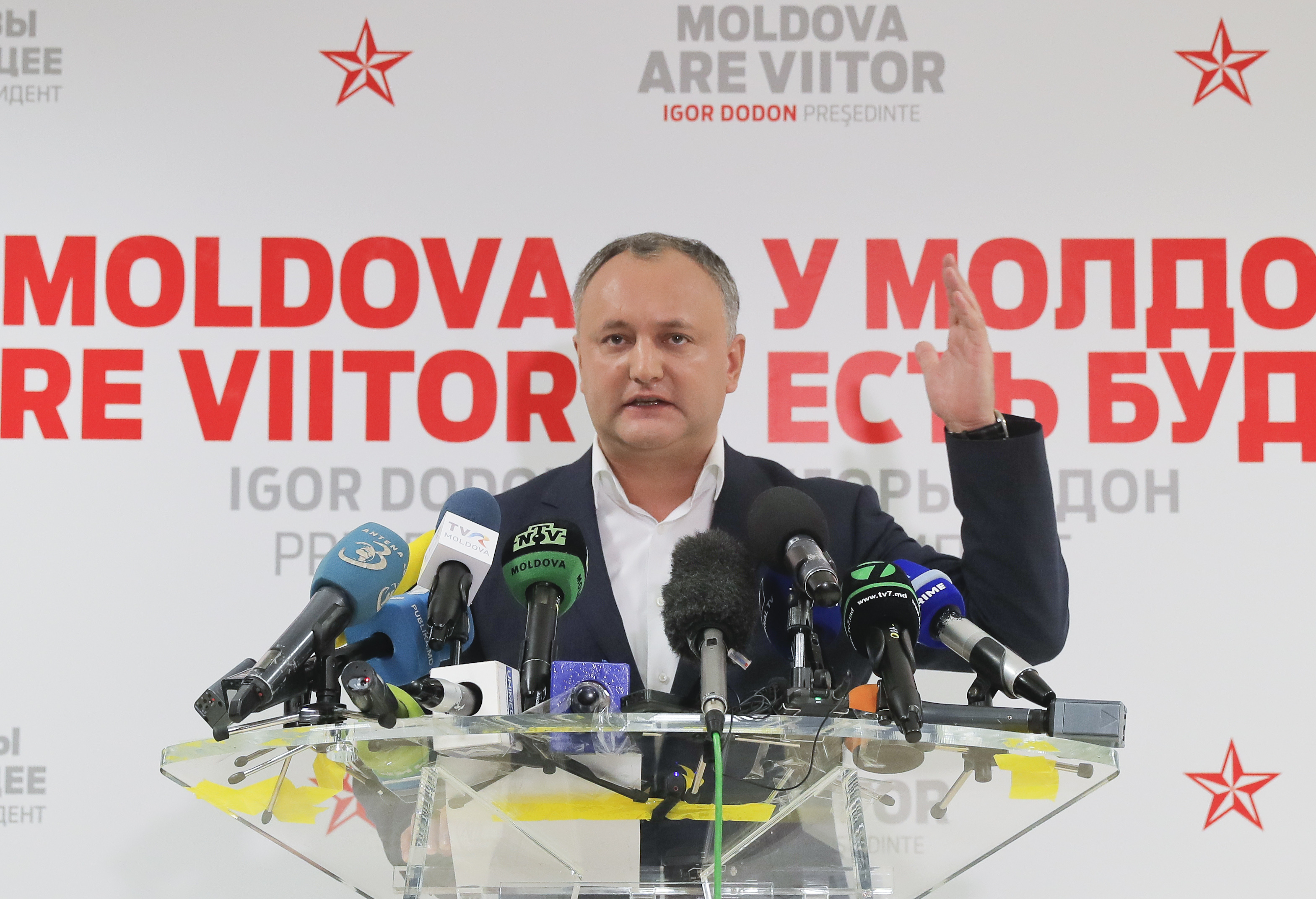 Socialist Party presidential candidate Igor Dodon speaks to the media after voting ended in the presidential elections, in Chisinau, Moldova, Nov. 13, 2016. Dodon, who campaigned on promises to restore closer ties with Russia, was running against pro...
