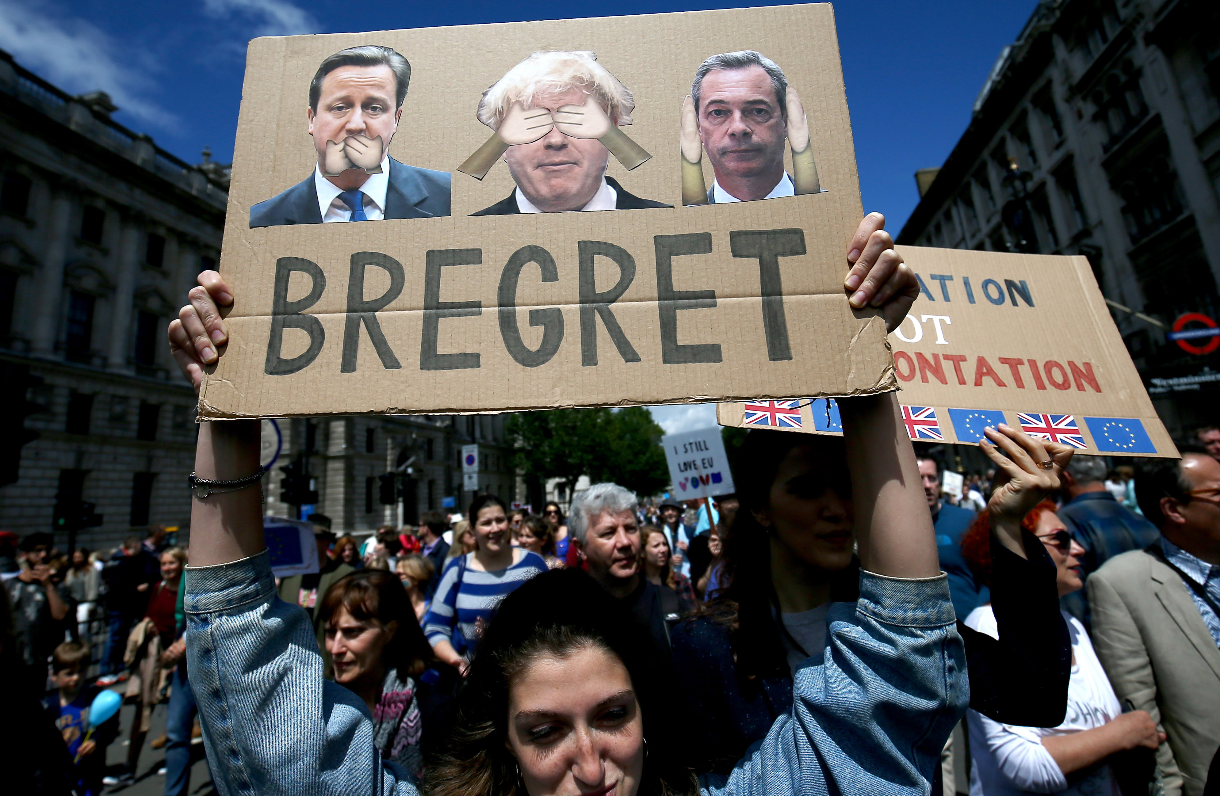 People hold banners during a 'March for Europe' demonstration against Britain's decision to leave the European Union, in central London, Britain, July 2, 2016.
