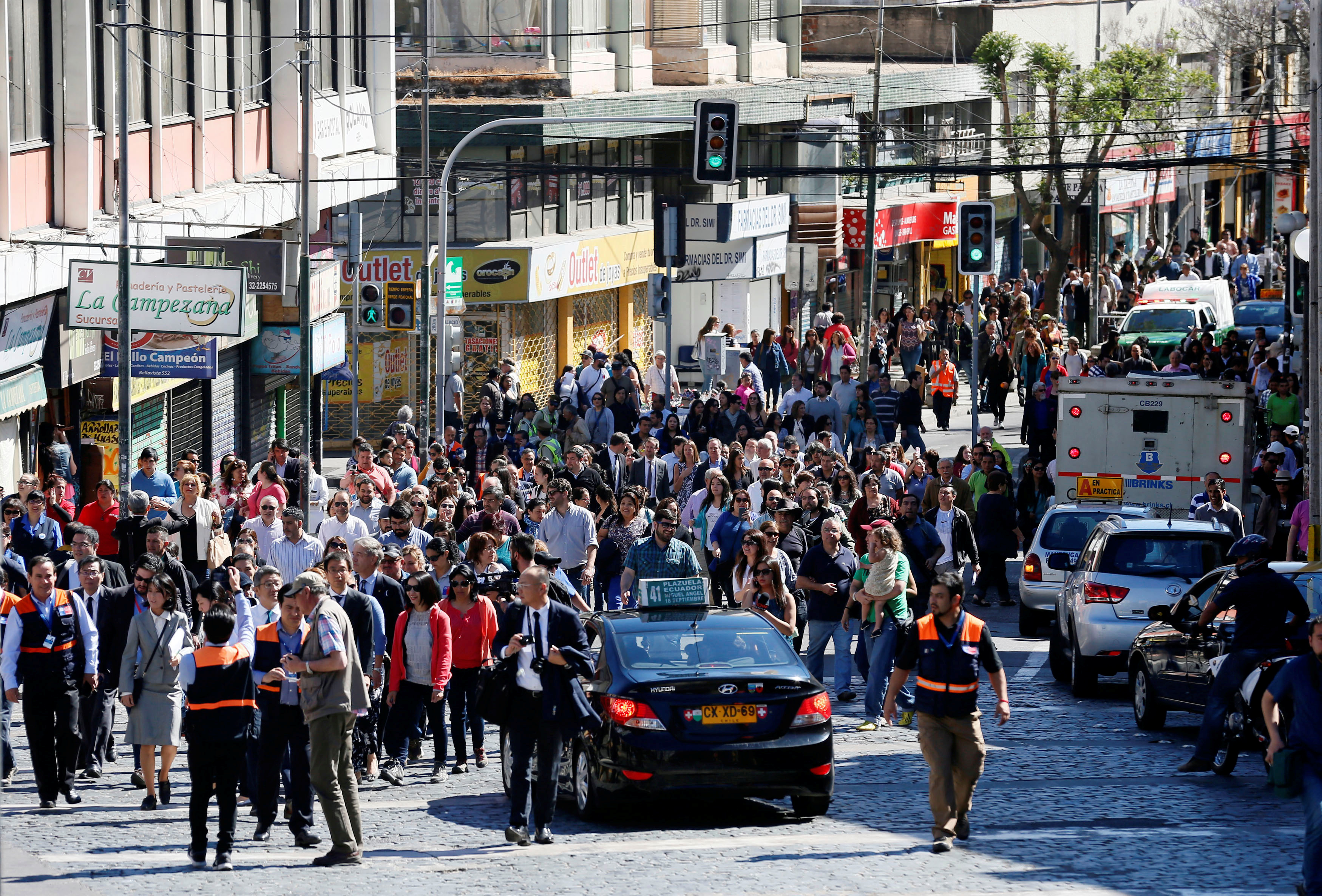 Citizens take part in a mass evacuation during a simulated disaster by a fictitious tsunami to mark World Tsunami Day on the Pacific coast in Valparaiso, Chile Nov. 3, 2016.