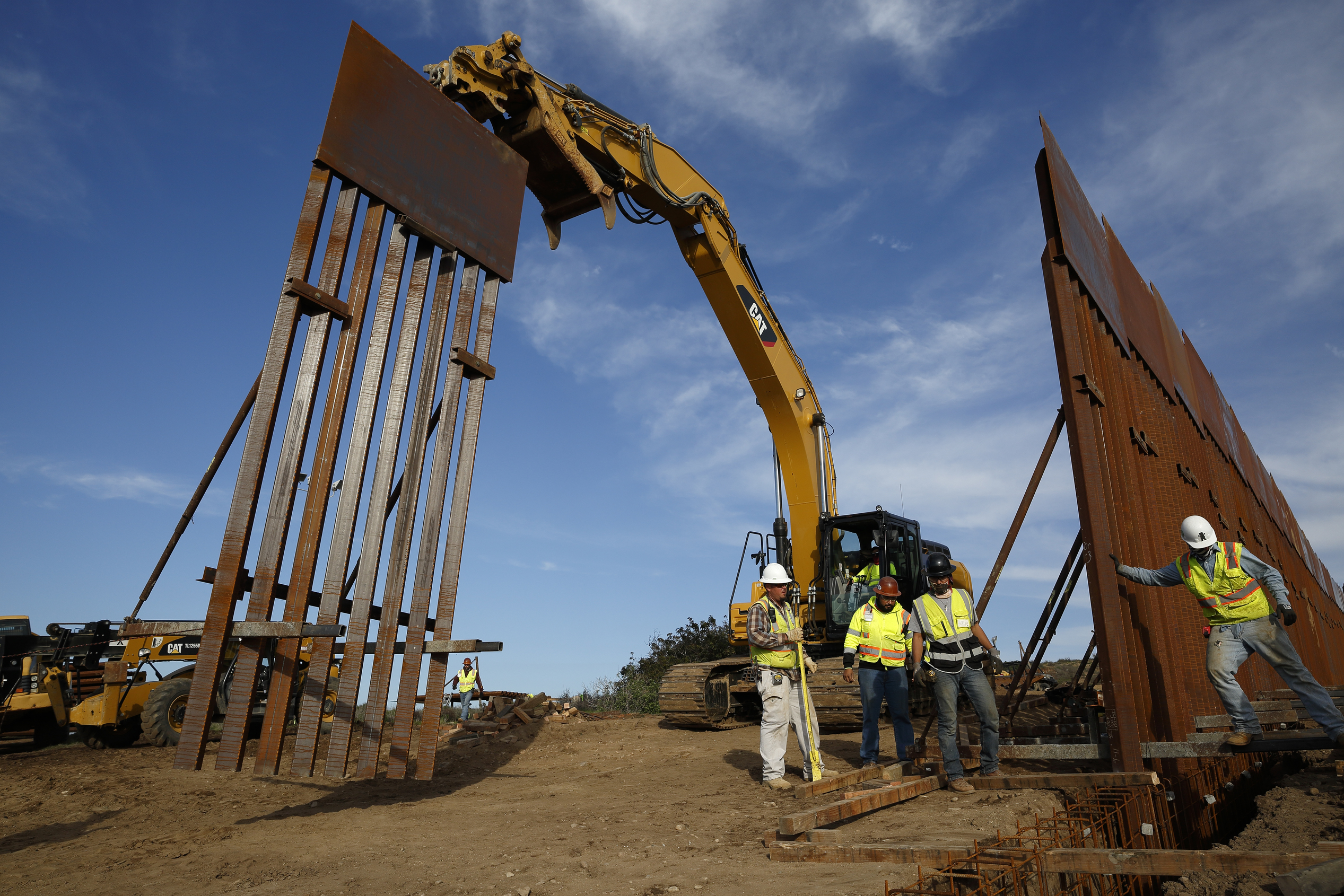 Construction crews install new border wall sections, Jan. 9, 2019, seen from Tijuana, Mexico. U.S. President Donald Trump walked out of his meeting with congressional leaders Wednesday as efforts to end the 19-day partial government shutdown fell int...
