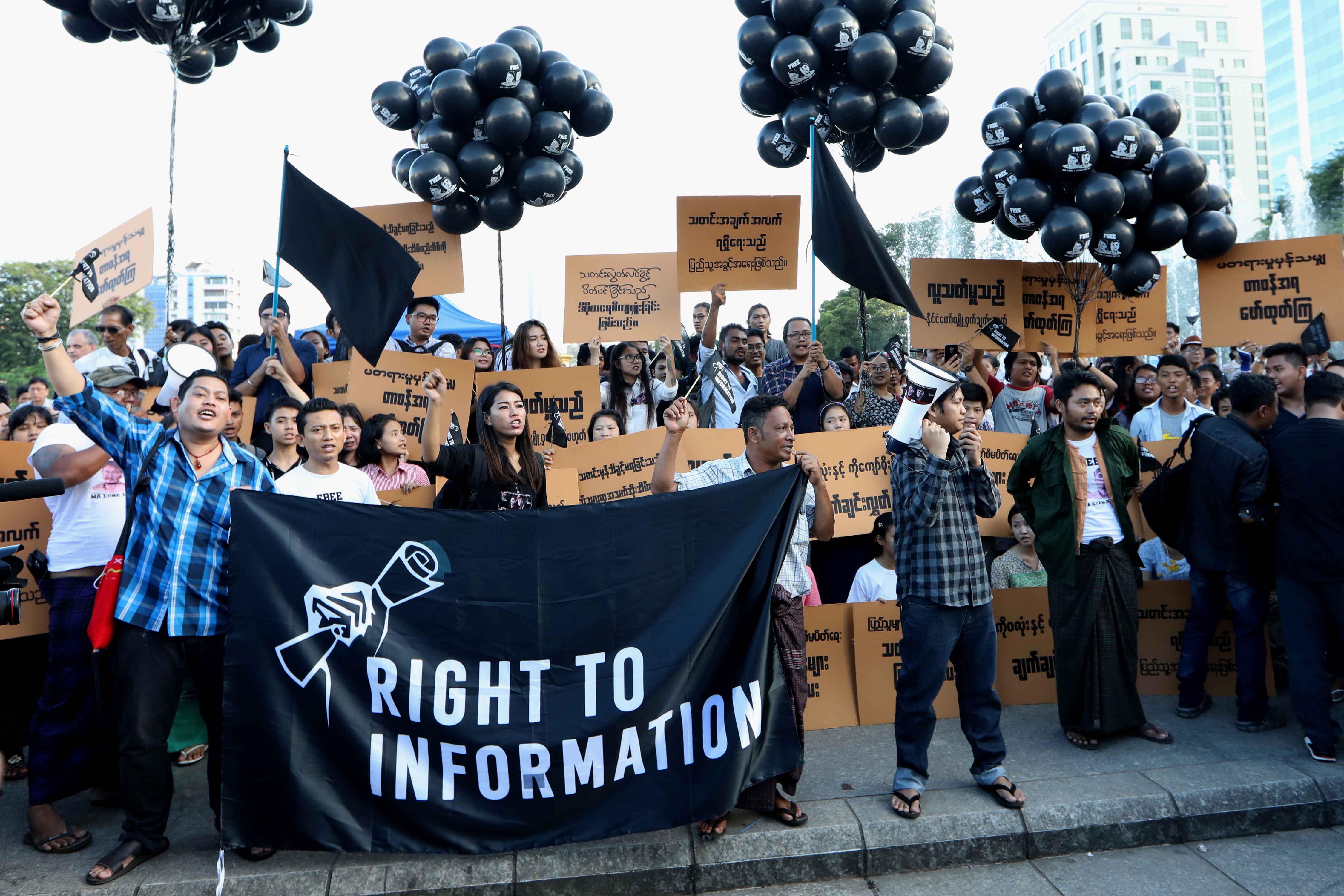 Myanmar press freedom advocates and youth activists hold a demonstration demanding the freedom of two jailed Reuters journalists Wa Lone and Kyaw Soe Oo in Yangon, Myanmar, Sept. 16, 2018.