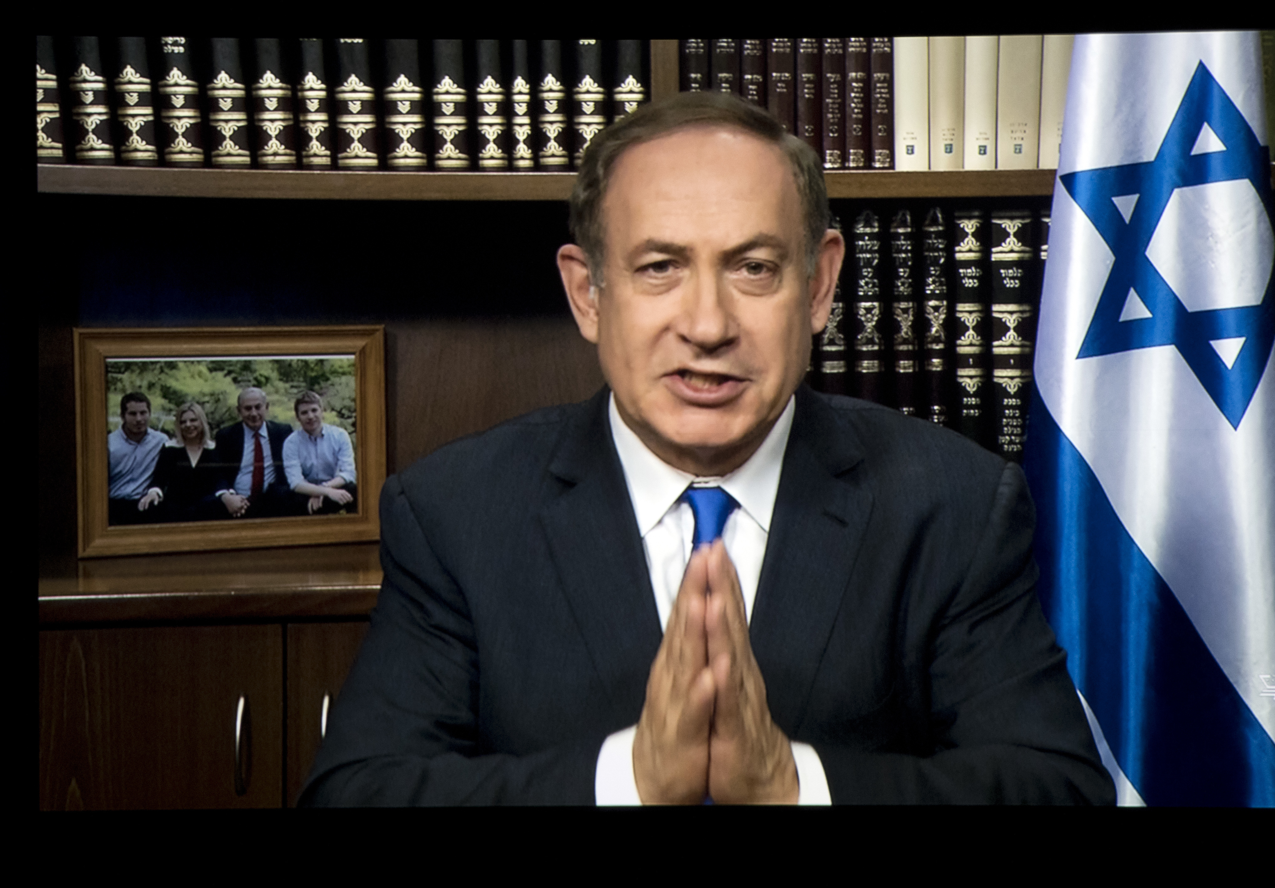 Israeli Prime Minister Benjamin Netanyahu is projected on a screen in Washington as he speaks to attendees of the AIPAC Policy Conference 2017 via satellite from Israel, March 27, 2017, in Washington.