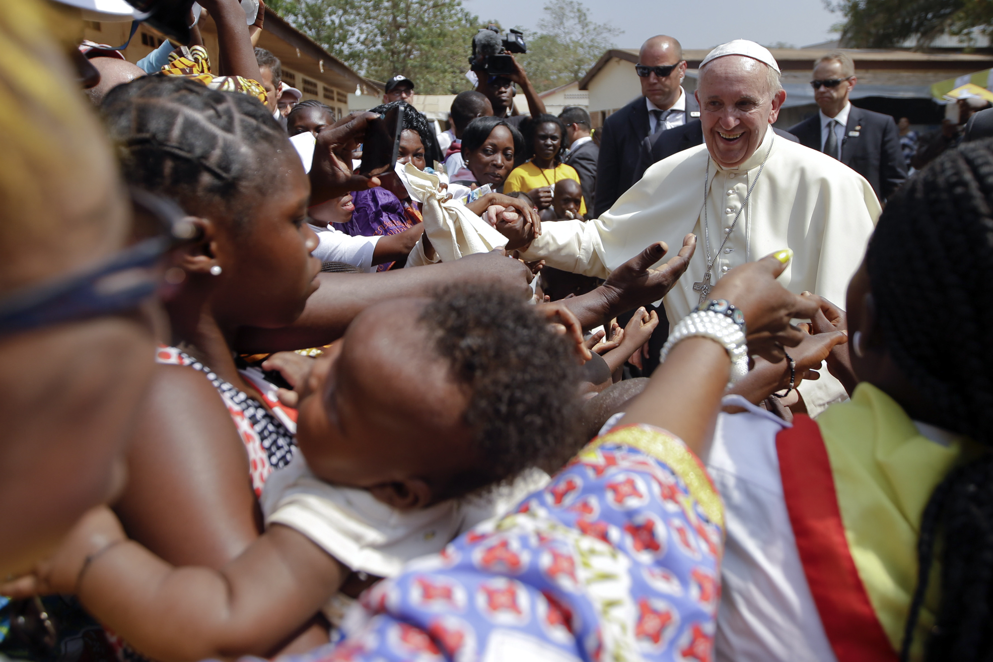 Pope Francis is cheered by locals as he visits a refugee camp, in Bangui, Central African Republic, Nov. 29, 2015.