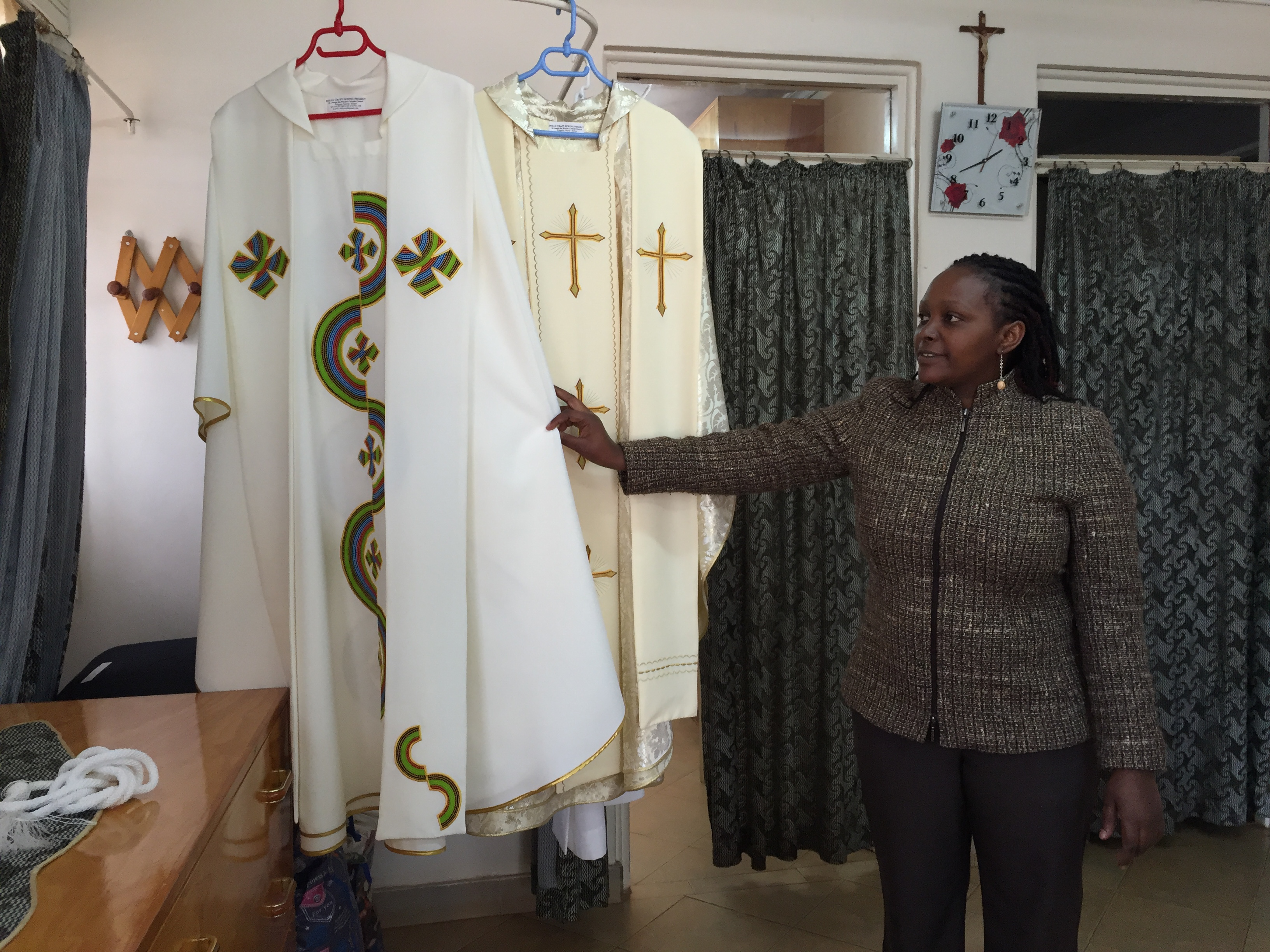 Sarah Ndungu, secretary and accountant for the Dolly Craft Sewing Project in Kangemi slum, Nairobi, shows the two chasubles her group designed and constructed for Pope Francis during his visit to Kenya later this month, Nov. 12, 2015. (Photo: J. Crai...
