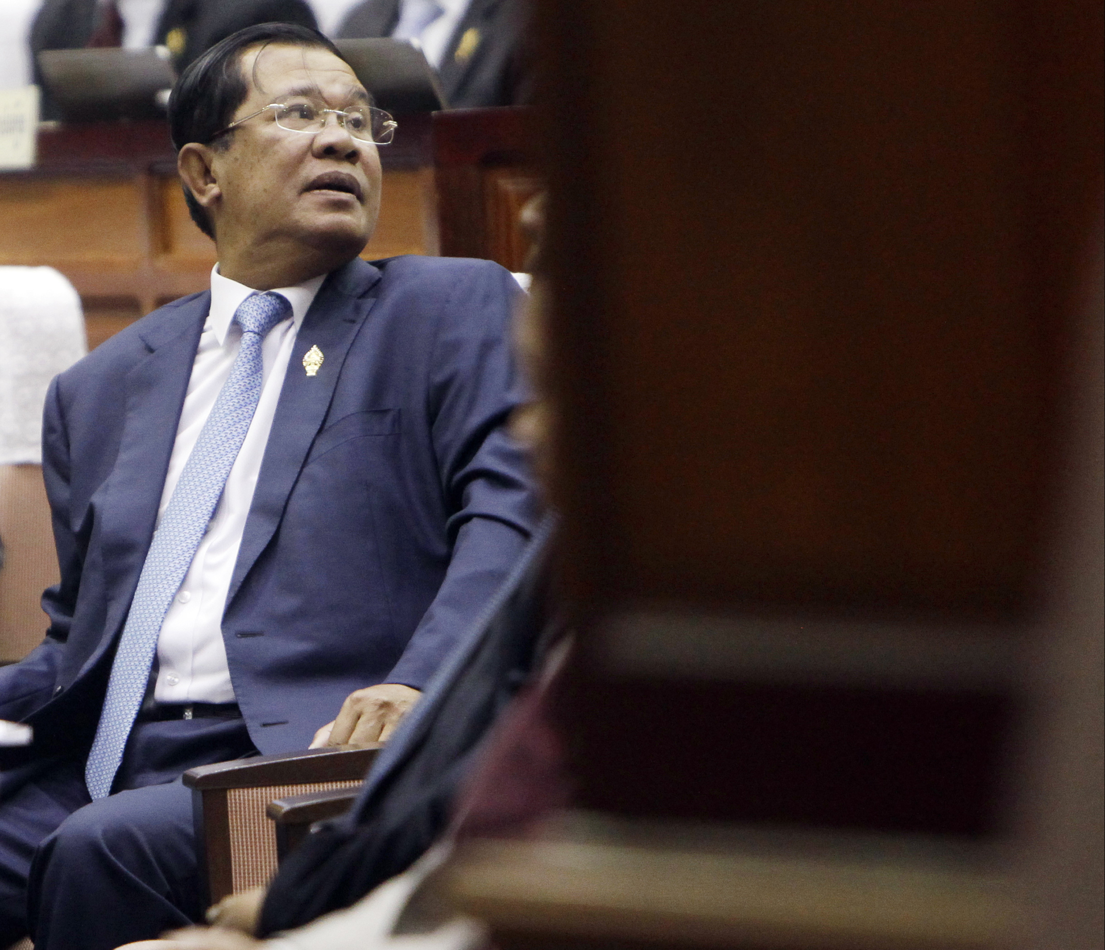 Cambodia's Prime Minister Hun Sen waits in the hall of National Assembly before a meeting, in Phnom Penh, Cambodia, Monday, Feb. 20, 2017.