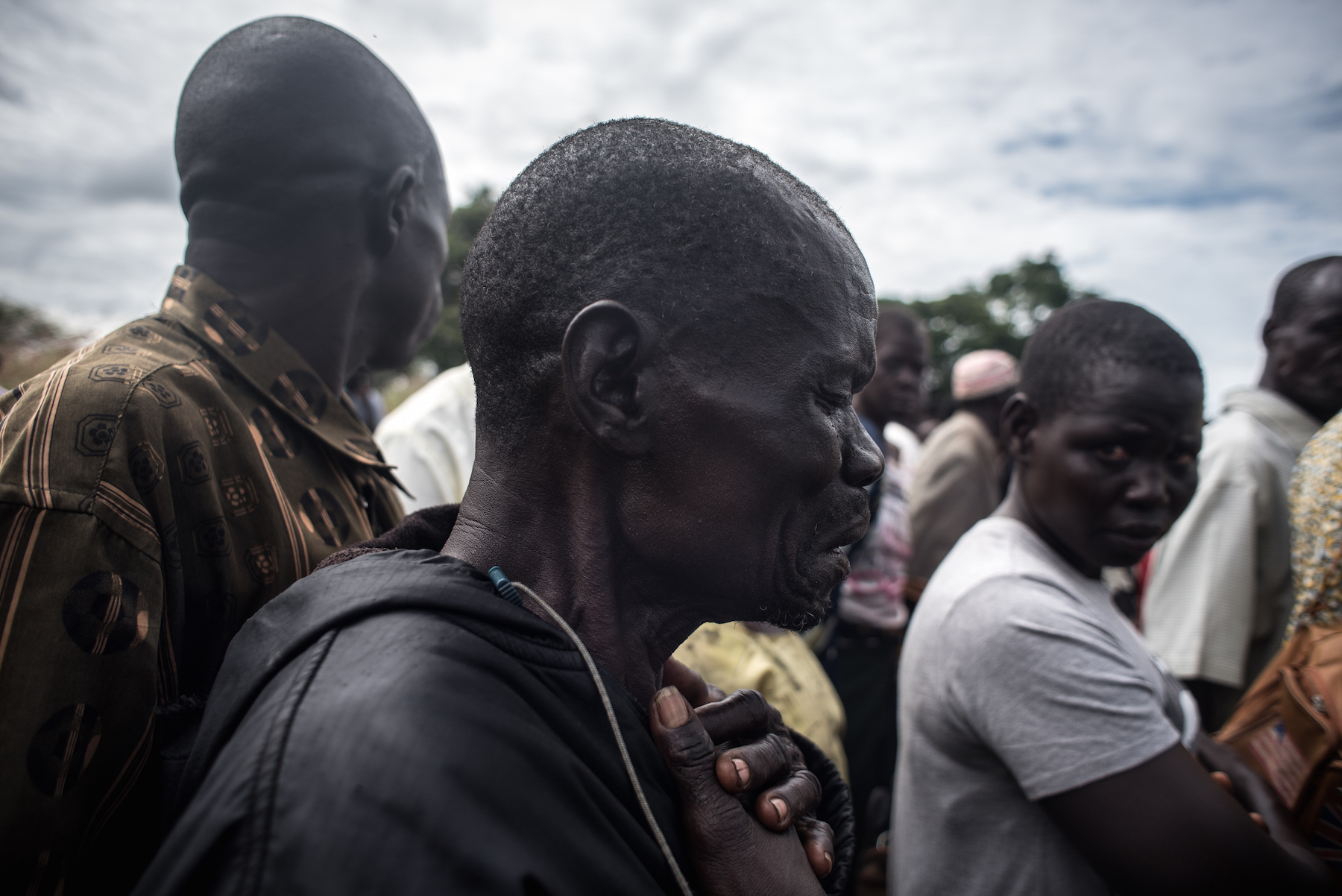 Moses Sokiri, whose son Duku Evans was killed November 3 amid fighting between government troops and rebels in Logo displaced persons camp in Kajo Keji, South Sudan, weeps at his son's funeral on the Ugandan border, Nov. 5, 2017.