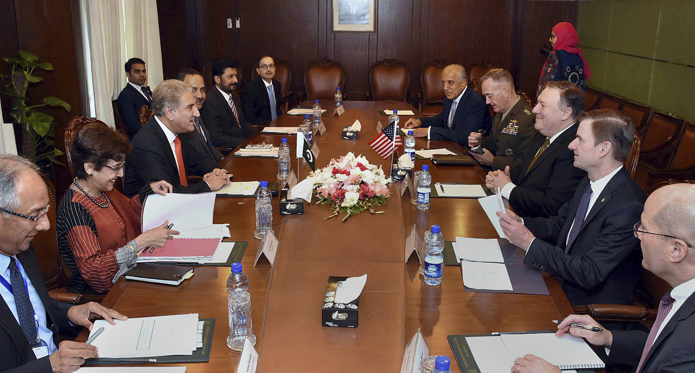 In this photo released by Press Information Department, visiting U.S. Secretary of State Mike Pompeo, third right, talks with Pakistan's foreign minister Shah Mahmood Qureshi, third left, in Islamabad, Sept. 5, 2018.