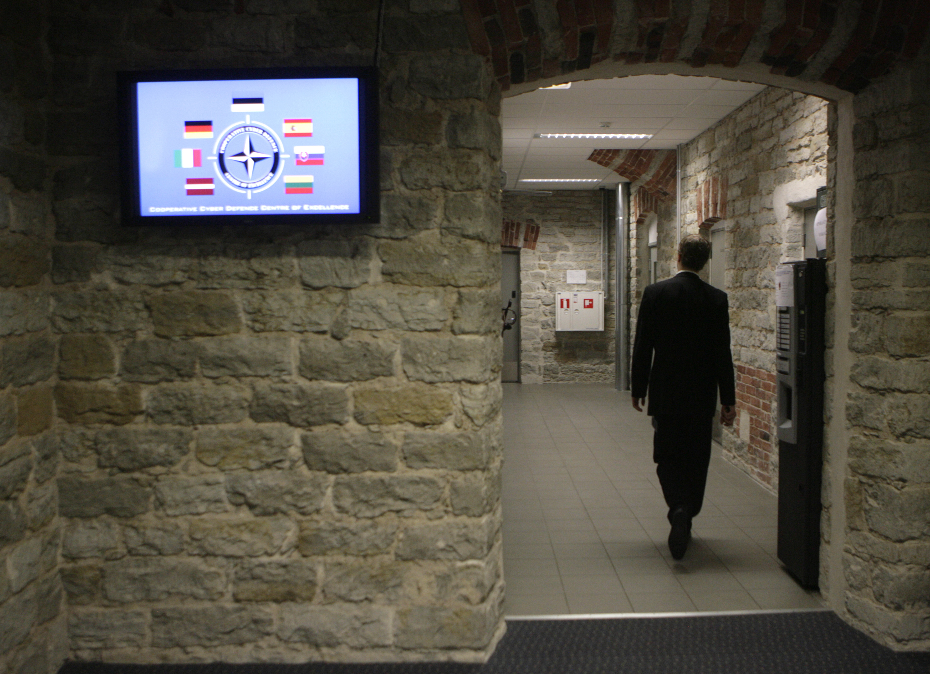 FILE - A staffer of the NATO Cooperative Cyber Defense Center of Excellence is seen walking through a restricted operational area of the center in Tallinn, Estonia.