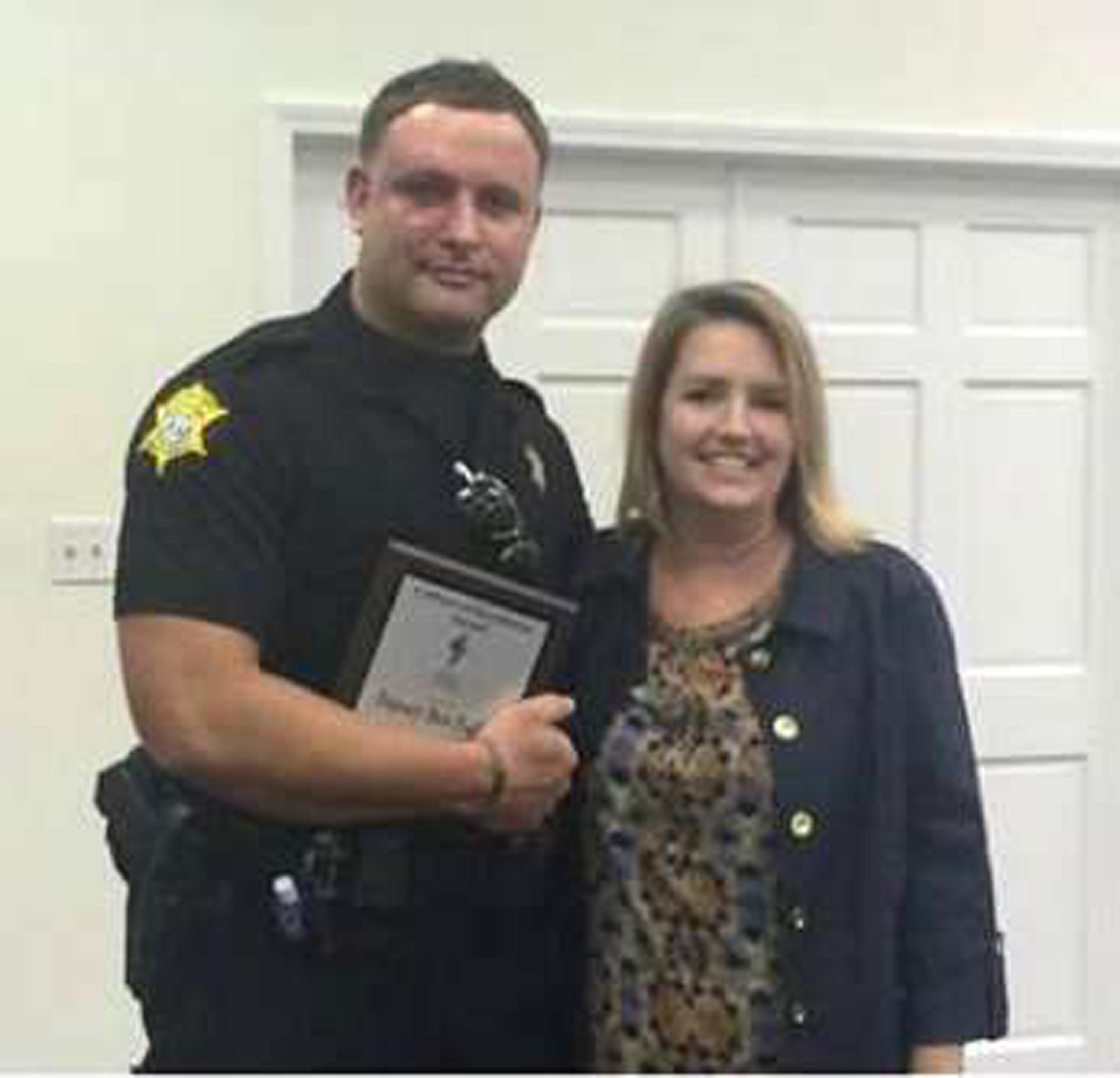 Richland County Sheriff's Department Officer Senior Deputy Ben Fields, left, is pictured with Lonnie B. Nelson Elementary School Principal Karen Beaman after receiving Culture of Excellence Award, in Columbia, S.C., Nov. 12, 2014.