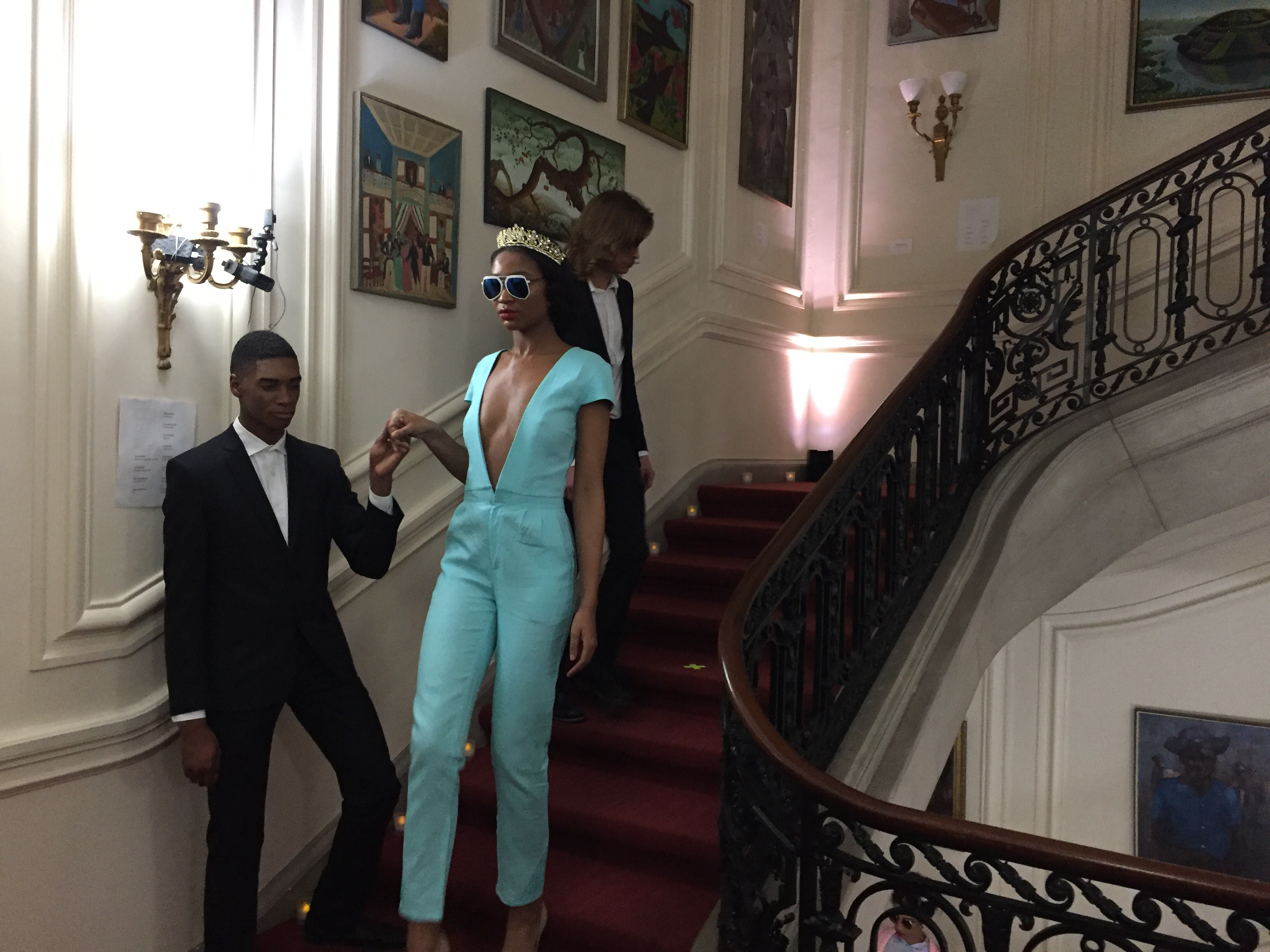 "Model wears sexy jumpsuit from designer Prajje Oscar's ""Ezili"" collection at the Haitian Embassy's ""Fashion By Design"" event in Washington, D.C. Feb. 23, 2018. (Photo: S. Lemaire / VOA)"