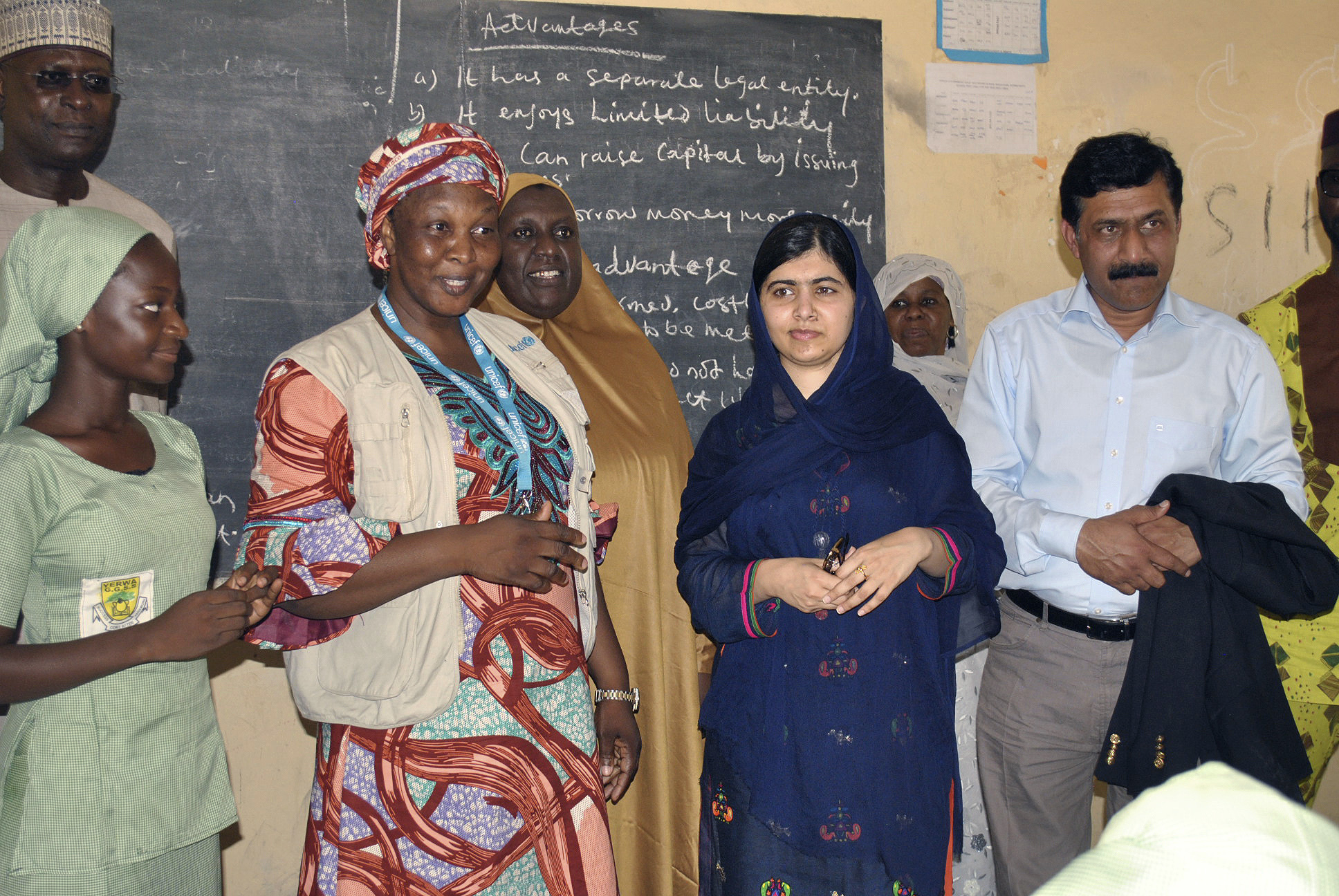 Pakistani activist Malala Yousafzai, center right, visits a school in Maiduguri, Nigeria, July. 18, 2017. The Nobel Peace laureate spoke out for the many girls abducted under Boko Haram's deadly insurgency.
