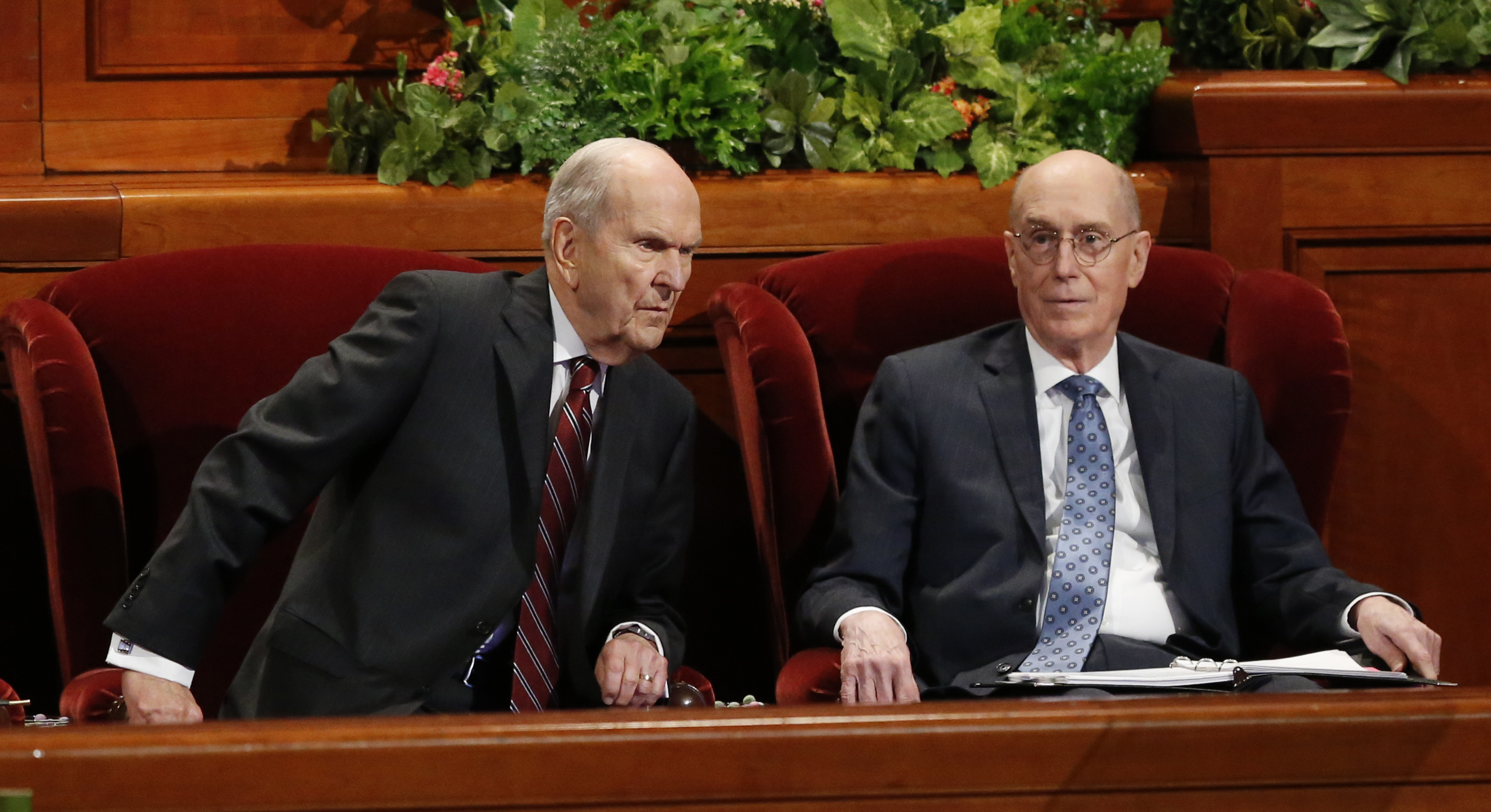 President Russell M. Nelson, left, and his counselor Henry B. Eyring look on during the twice-annual conference of the Church of Jesus Christ of Latter-day Saints, Oct. 6, 2018, in Salt Lake City.