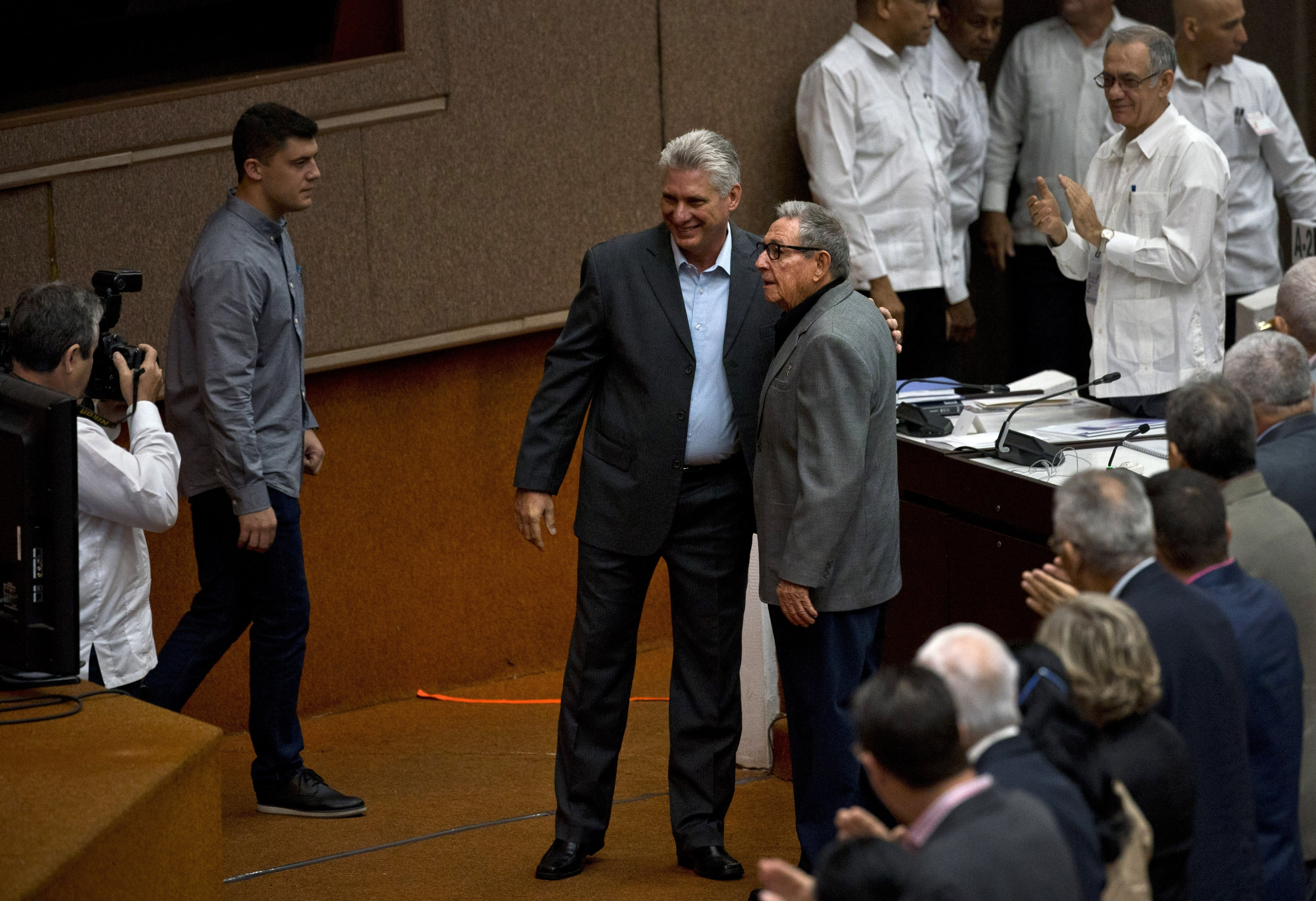 Cuba's President Miguel Diaz-Canel and former president Raul Castro, pose for a photo before the start of a session to debate the draft of a new Constitution, at the Convention Palace in Havana, Dec. 21, 2018.
