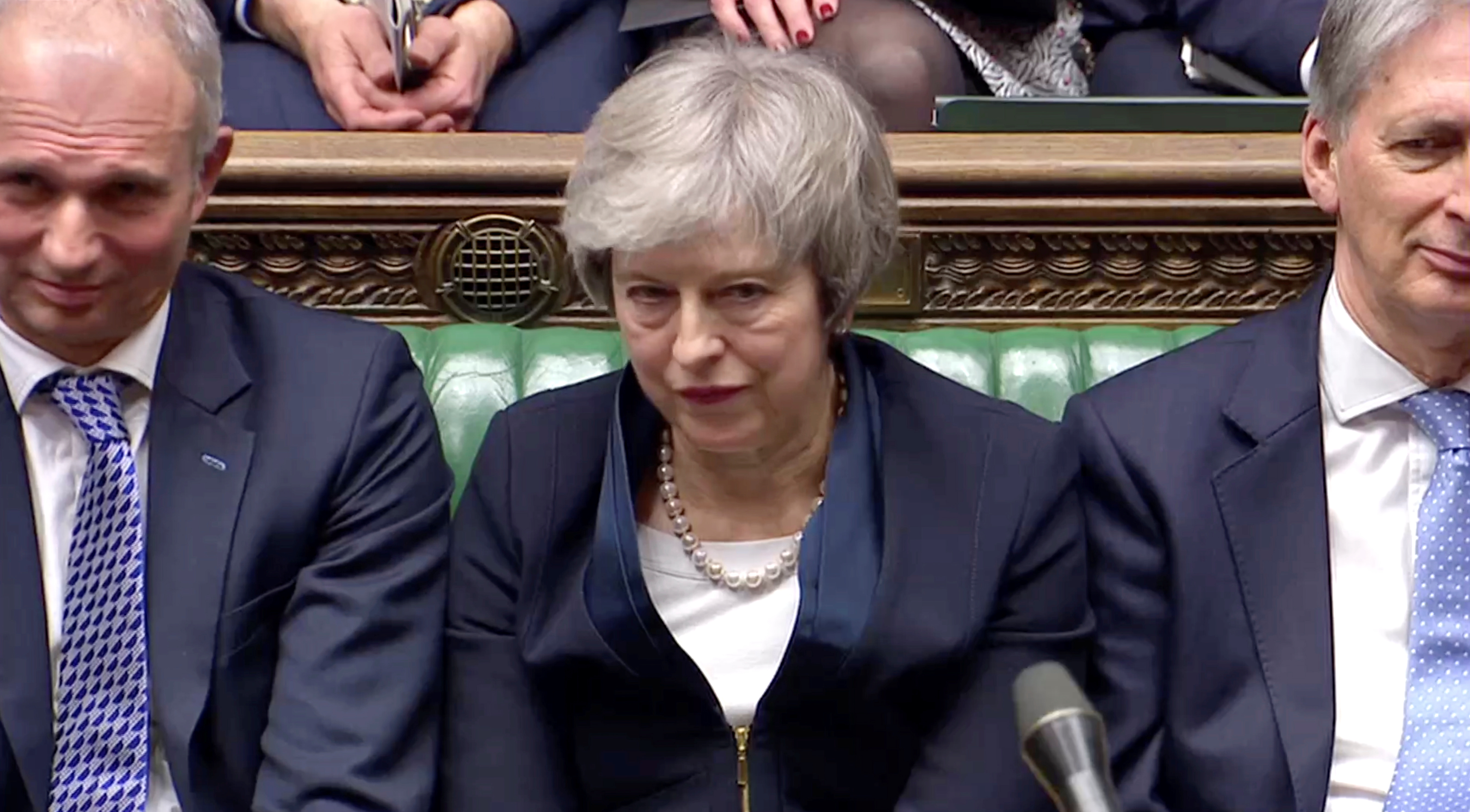 Prime Minister Theresa May sits down in Parliament after the vote on May's Brexit deal, in London, Britain, Jan. 15, 2019 in this image taken from video.