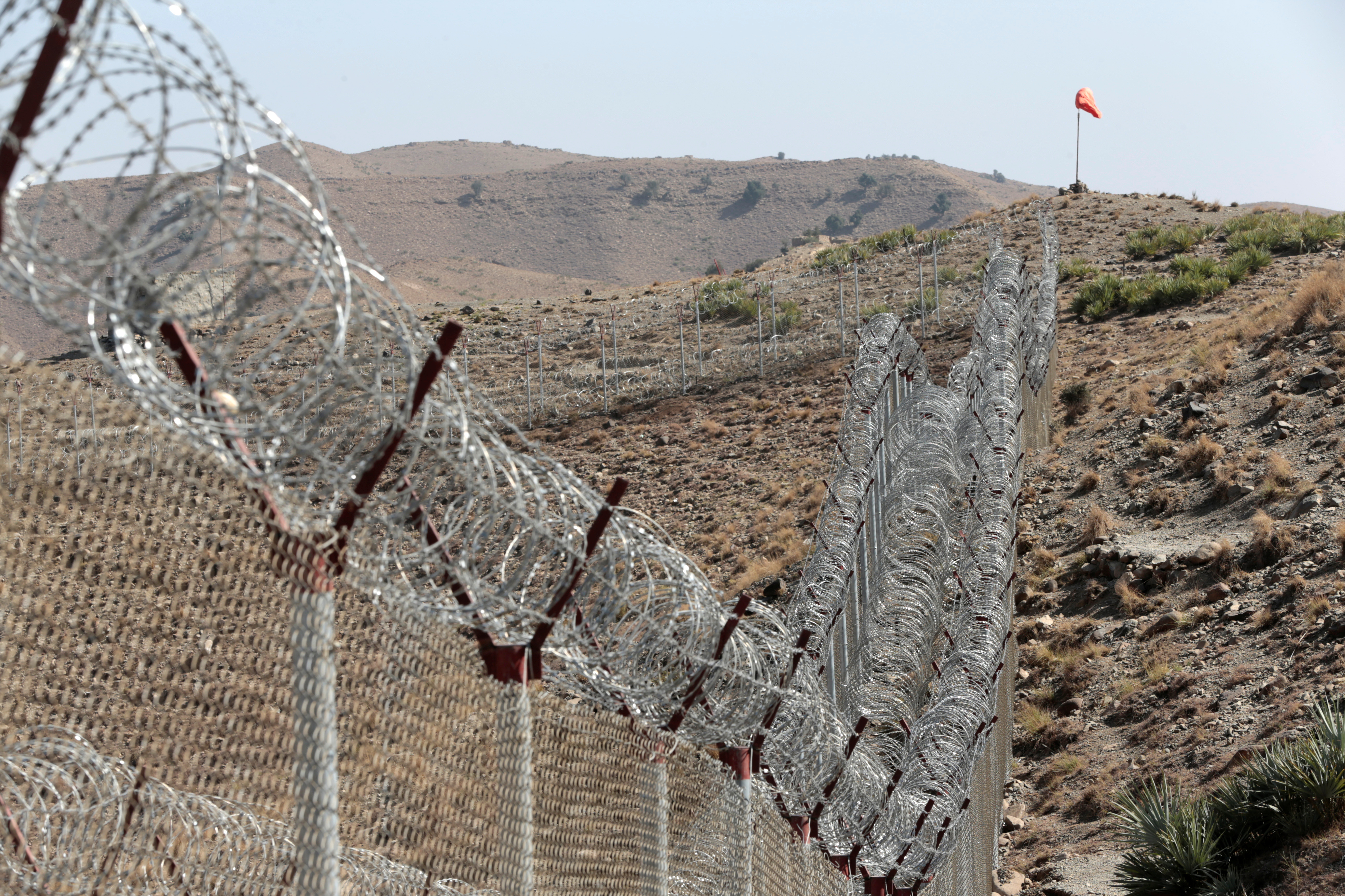A view of the border fence outside the Kitton outpost on the border with Afghanistan in North Waziristan, Pakistan, Oct. 18, 2017.