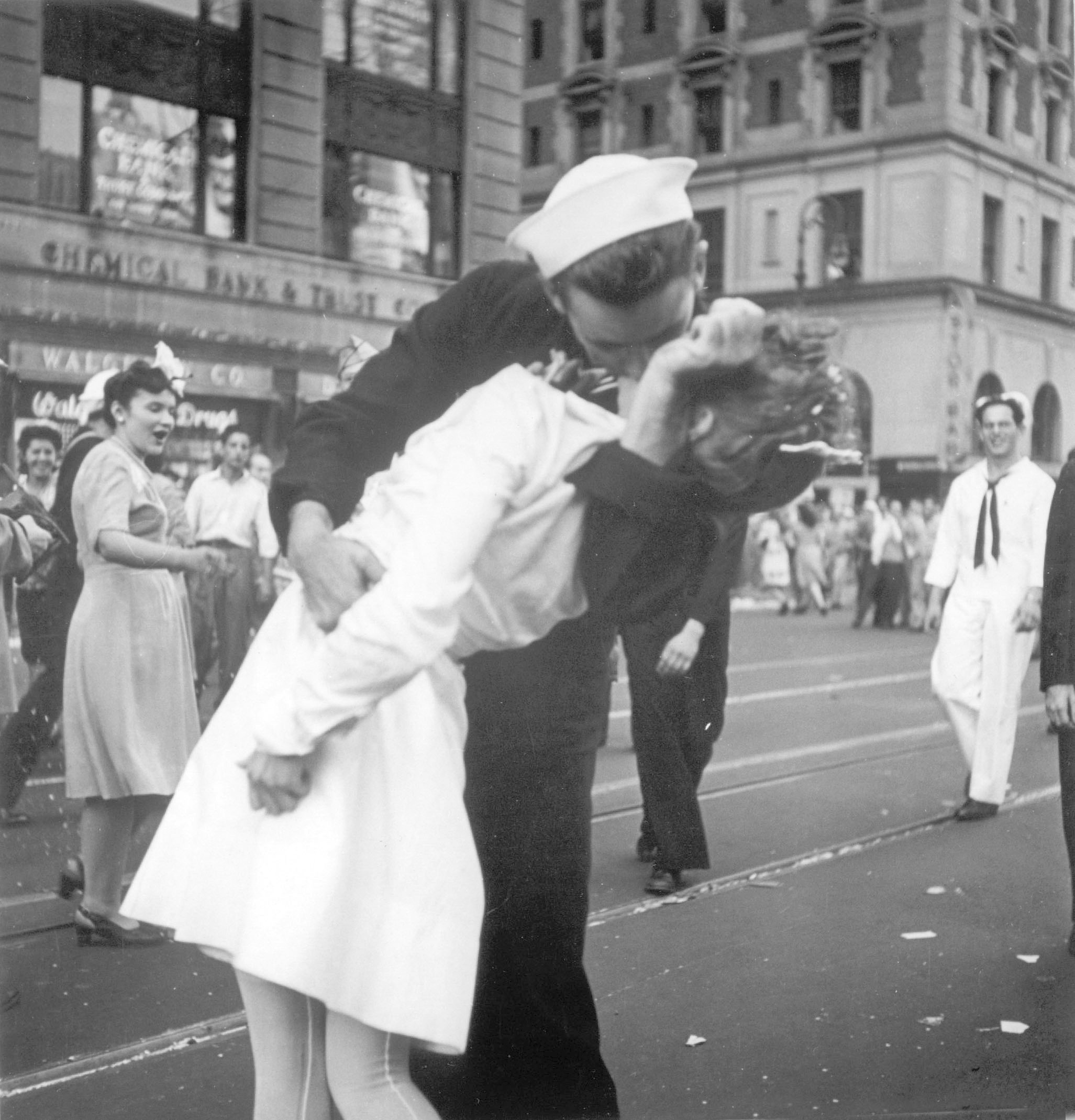 FILE - In a photo provided by the U.S. Navy, a sailor and a woman kiss in New York's Times Square, as people celebrate the end of World War II, Aug. 14, 1945. George Mendonsa was the young sailor in the photo.