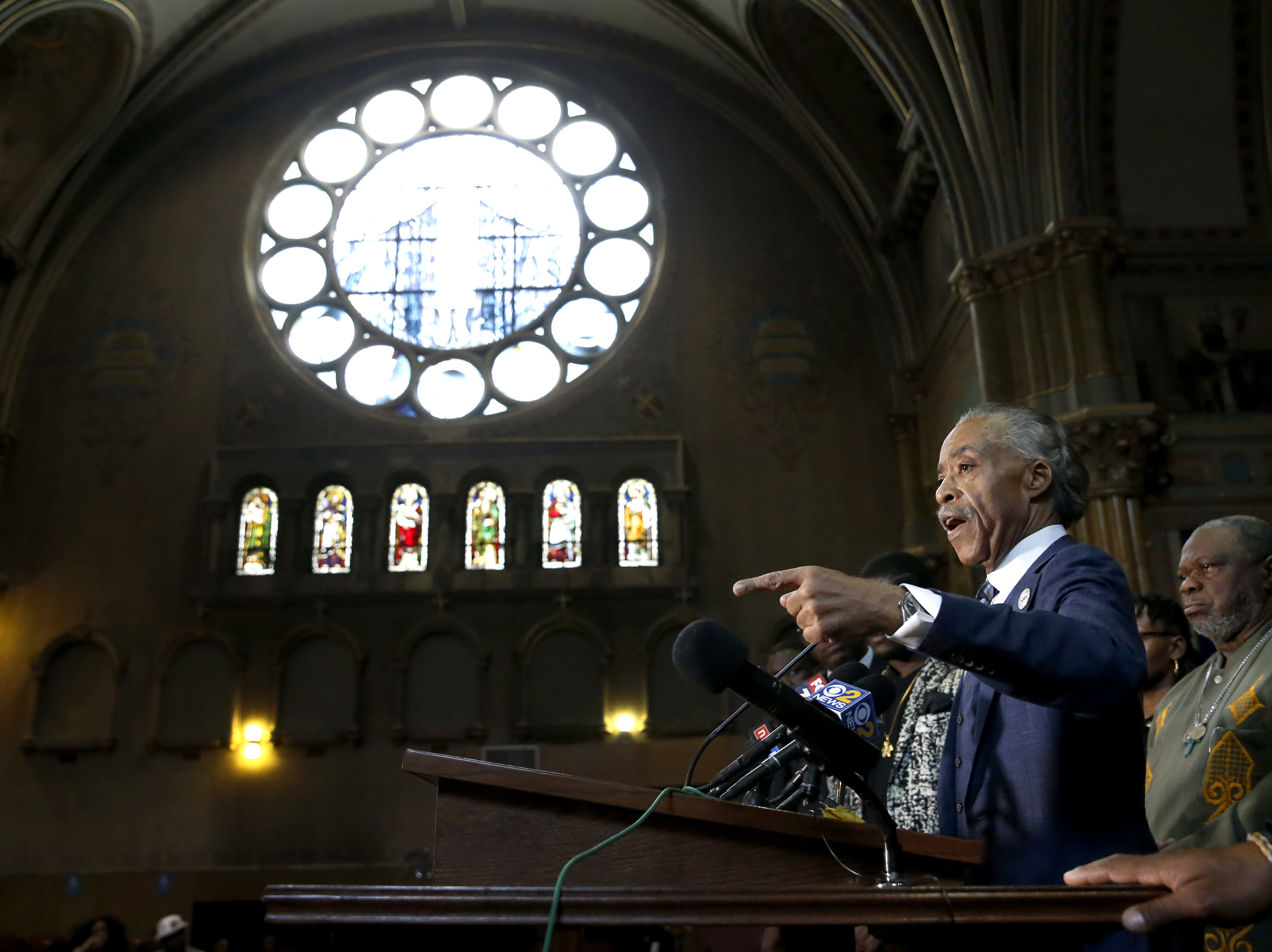 Rev. Al Sharpton stands with clergy and responds to a question during a news conference, July 13, 2017, in Chicago, where concerns were voiced over the announcement that more federal agents will be sent to Chicago without serious meetings with commun...