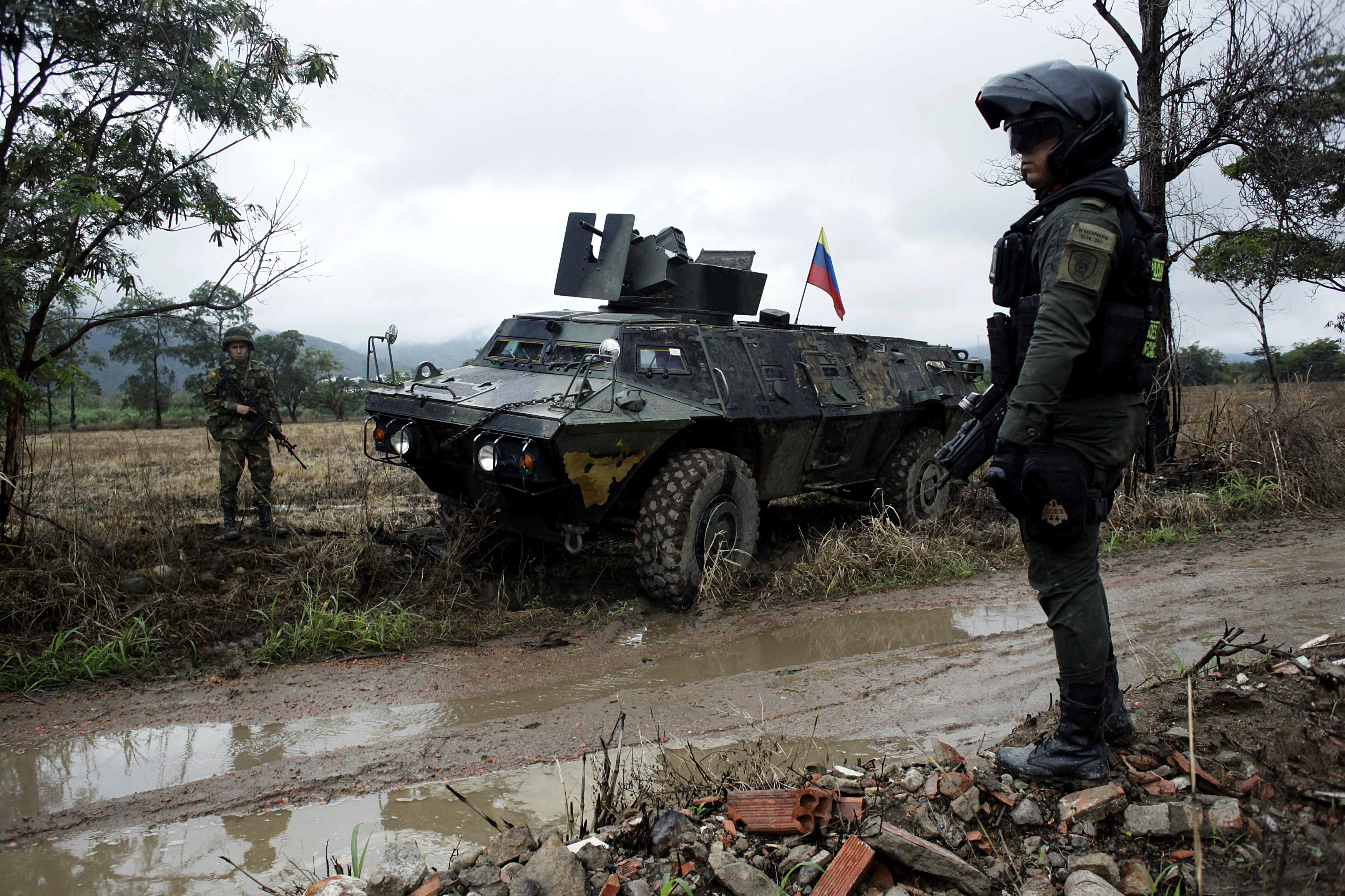 Colombian soldiers stand guard during a military operation at the border with Venezuela in Cucuta, Colombia, Feb. 13, 2018.