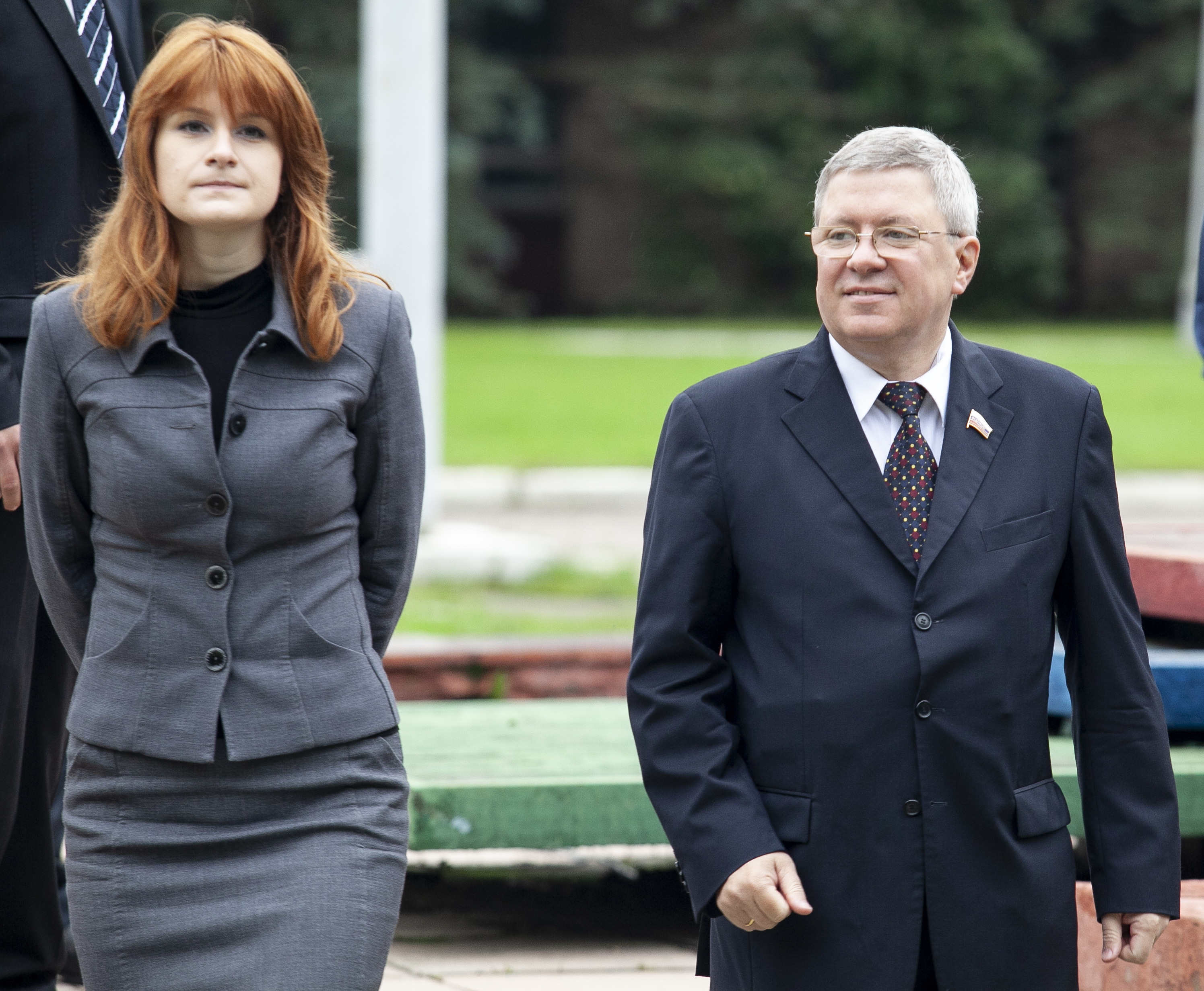 Maria Butina walks with Alexander Torshin then a member of the Russian upper house of parliament in Moscow, Russia, Sept. 7, 2012.