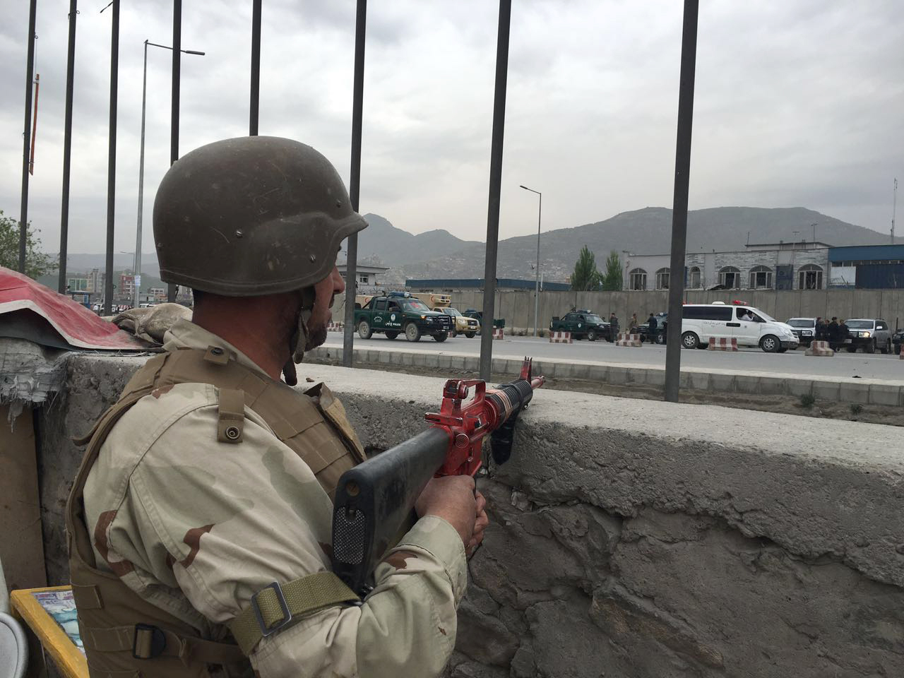 An Afghan soldier responds to a Taliban-claimed suicide attack in Kabul, Afghanistan, Tuesday, April 19, 2016.