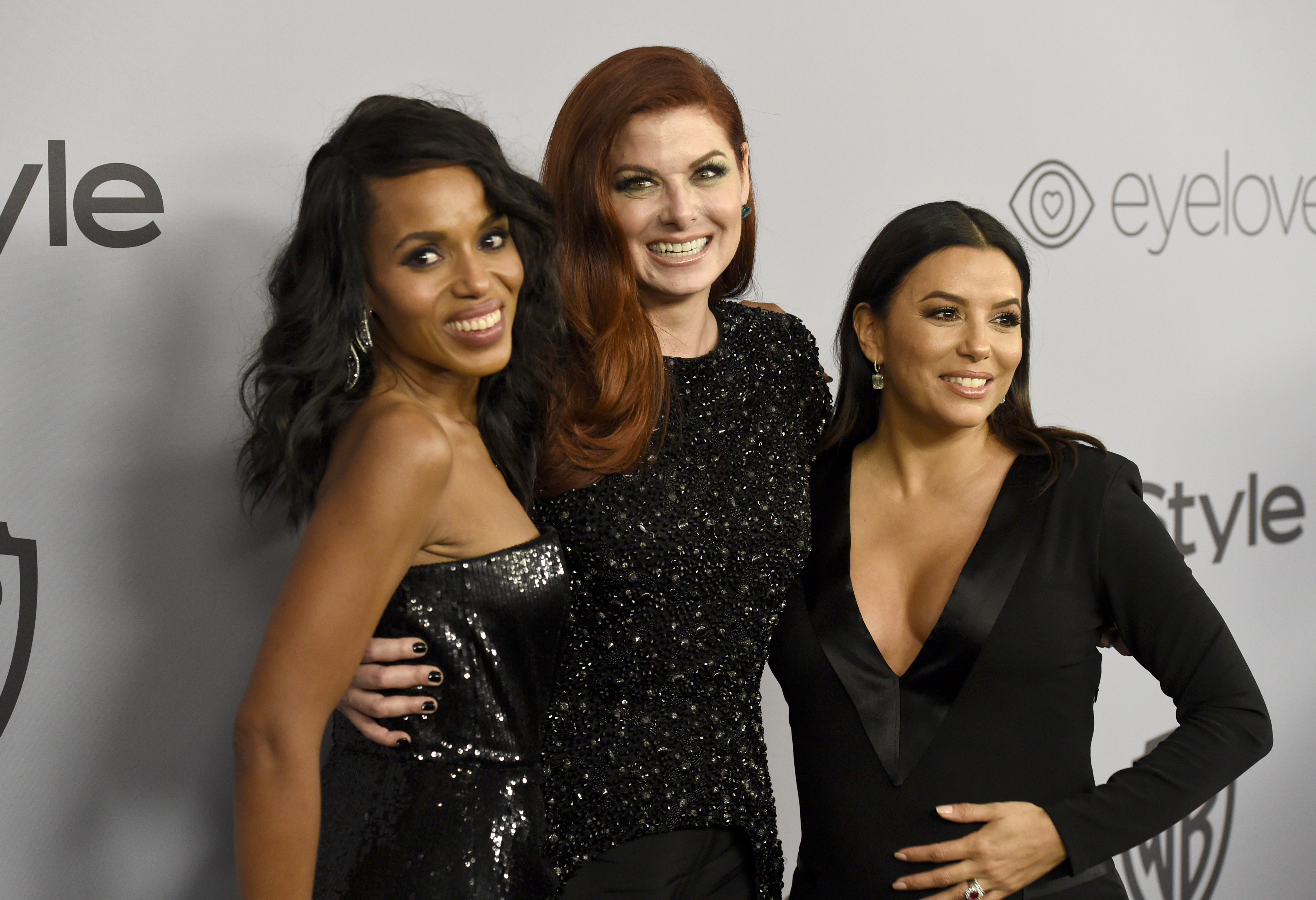Kerry Washington, from left, Debra Messing, and Eva Longoria arrive at the InStyle and Warner Bros. Golden Globes afterparty at the Beverly Hilton Hotel on Sunday, Jan. 7, 2018, in Beverly Hills, Calif.