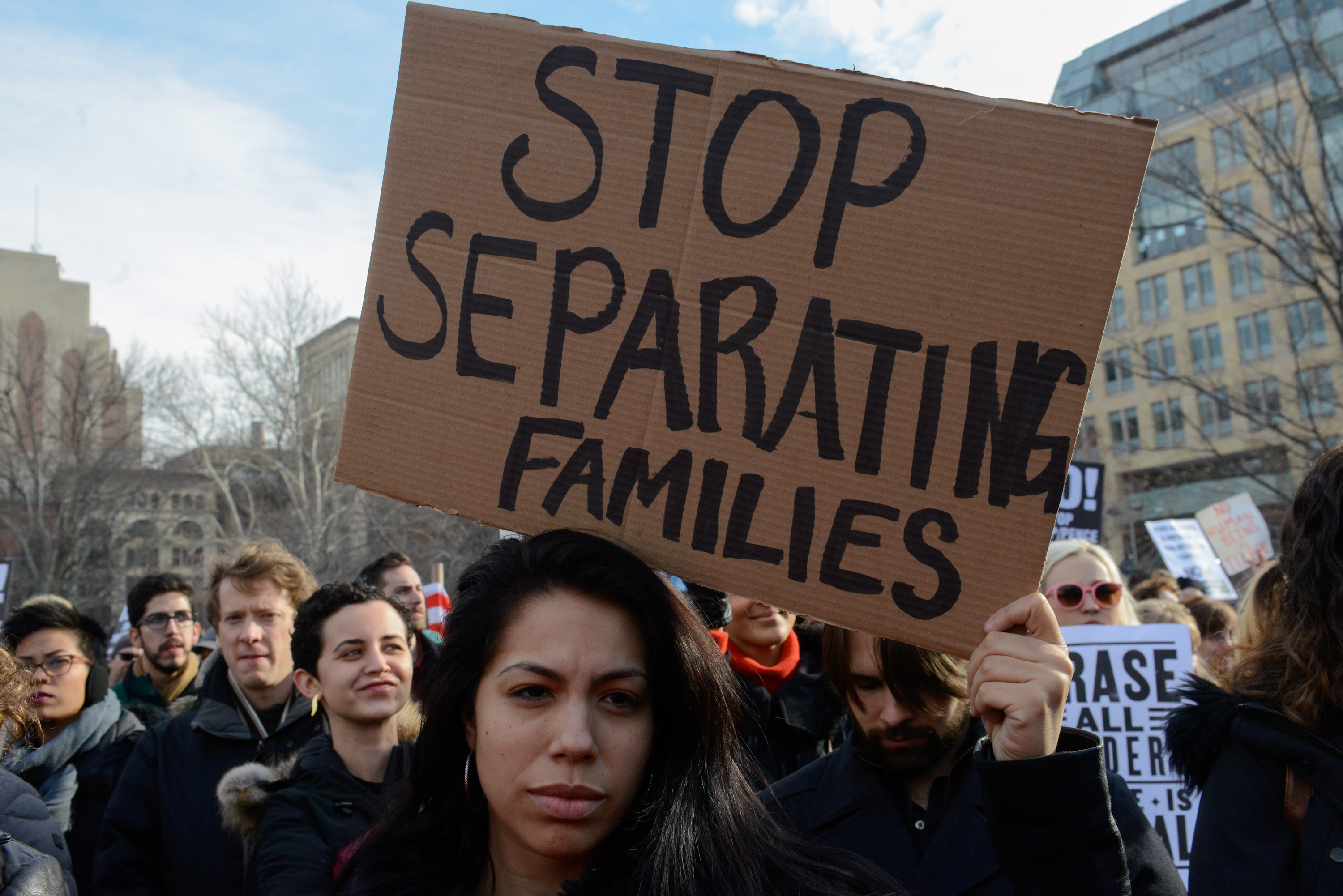 People participate in a protest against U.S. President Donald Trump's immigration policy and the recent Immigration and Customs Enforcement (ICE) raids in New York City, Feb. 11, 2017.