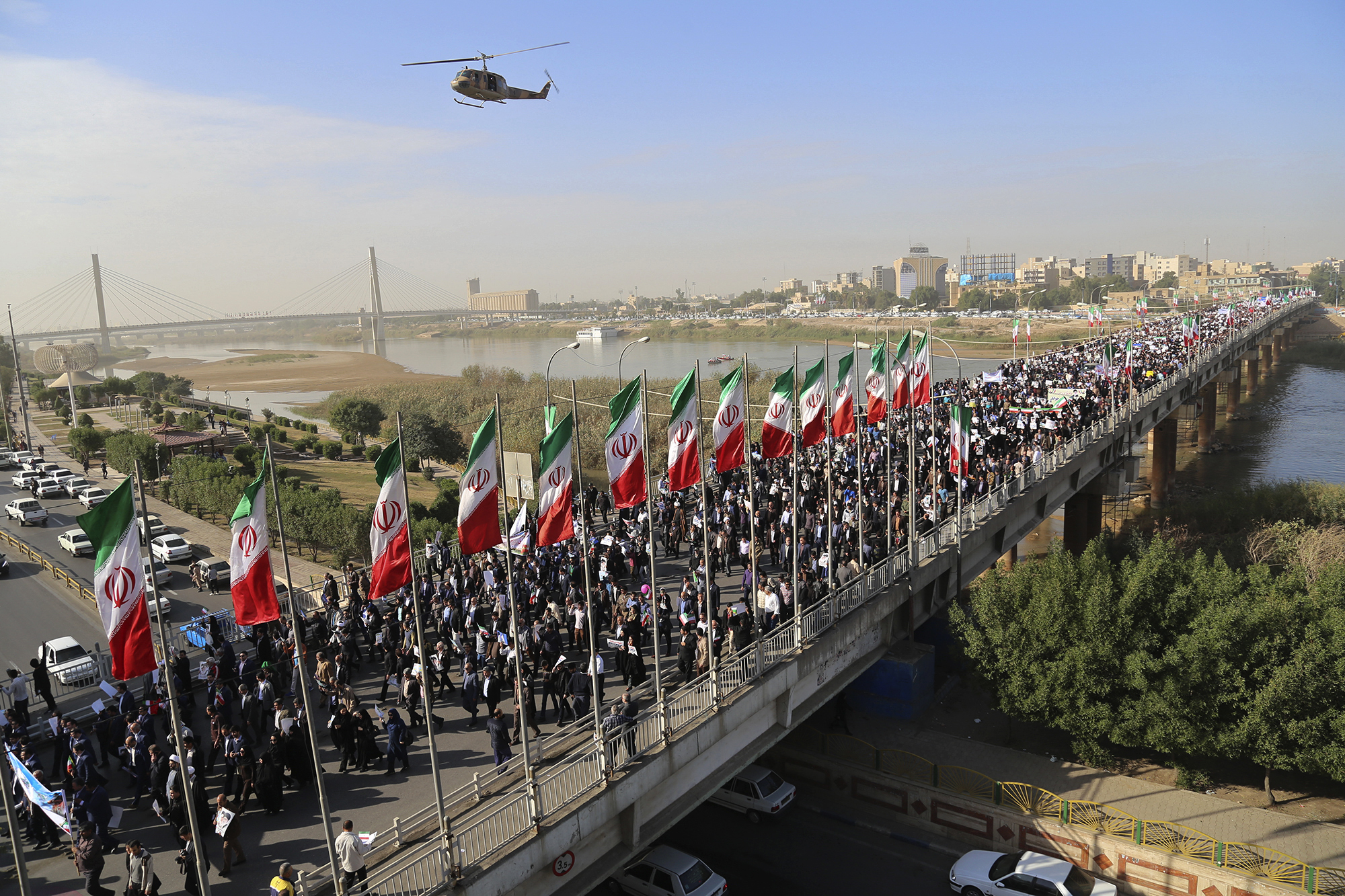 In this photo provided by Mehr News Agency, demonstrators attend a pro-government rally in the southwestern city of Ahvaz, Iran, Jan. 3, 2018.