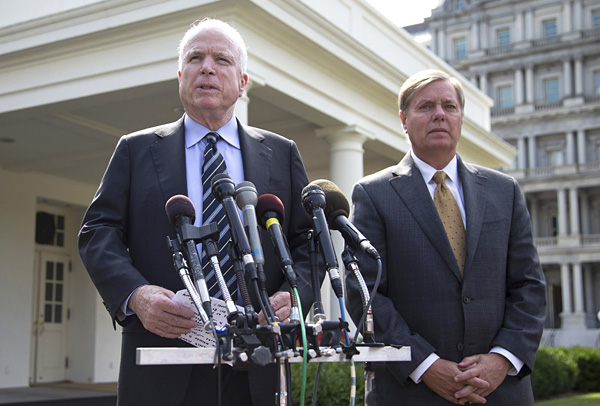 Senators John McCain (l) and Lindsey Graham, following a closed-door meeting with President Barack Obama to discuss the situation with Syria, Sept. 2, 2013.