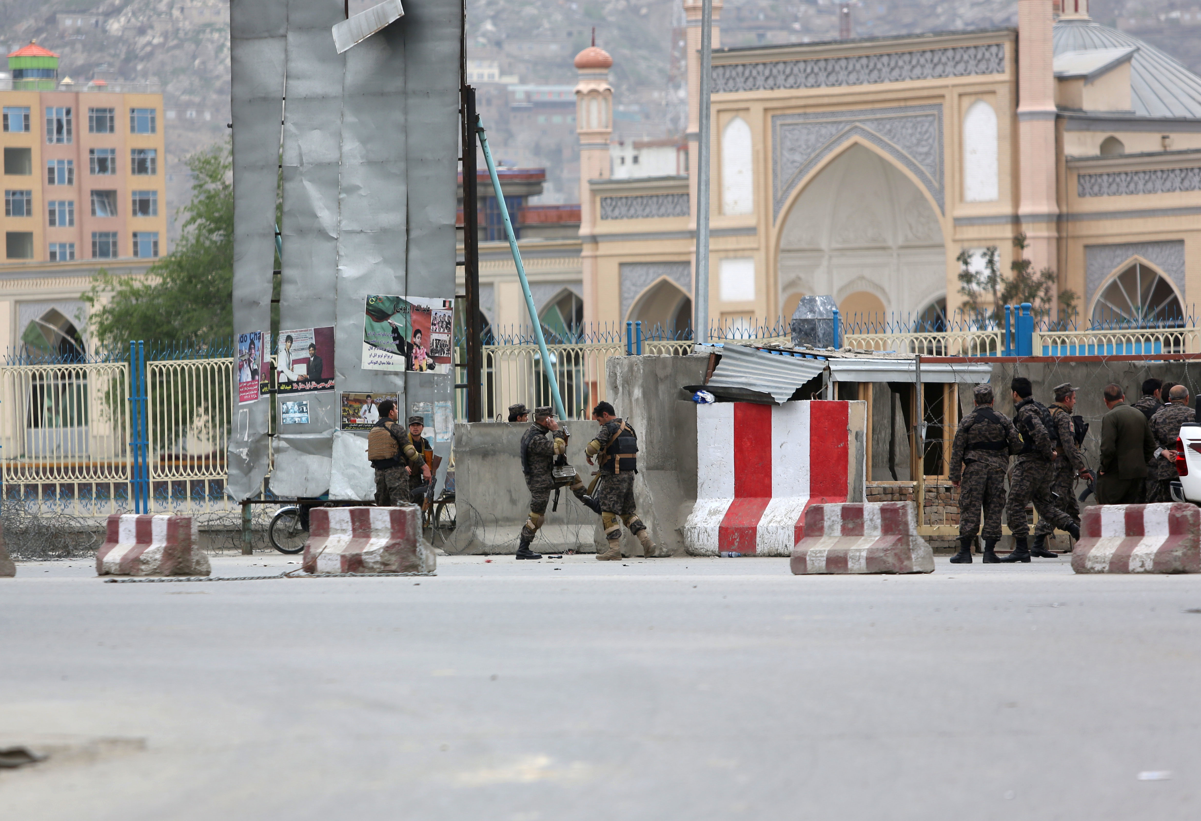 Afghan security forces responds to a Taliban-claimed suicide attack in Kabul, Afghanistan, Tuesday, April 19, 2016.