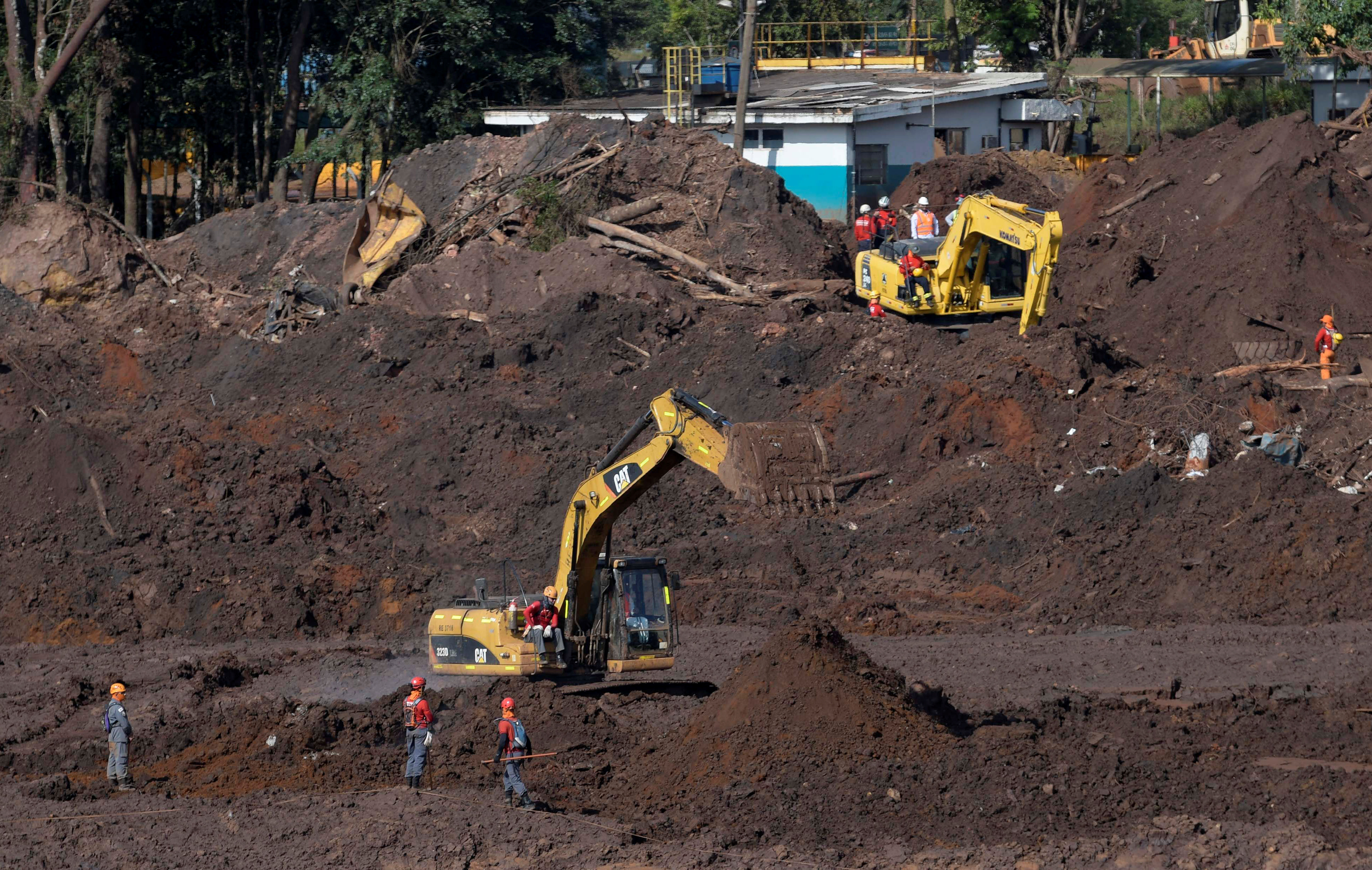 Members of a rescue team search for victims of a collapsed tailings dam owned by Brazilian mining company Vale SA, in Brumadinho, Brazil, Feb. 10, 2019.