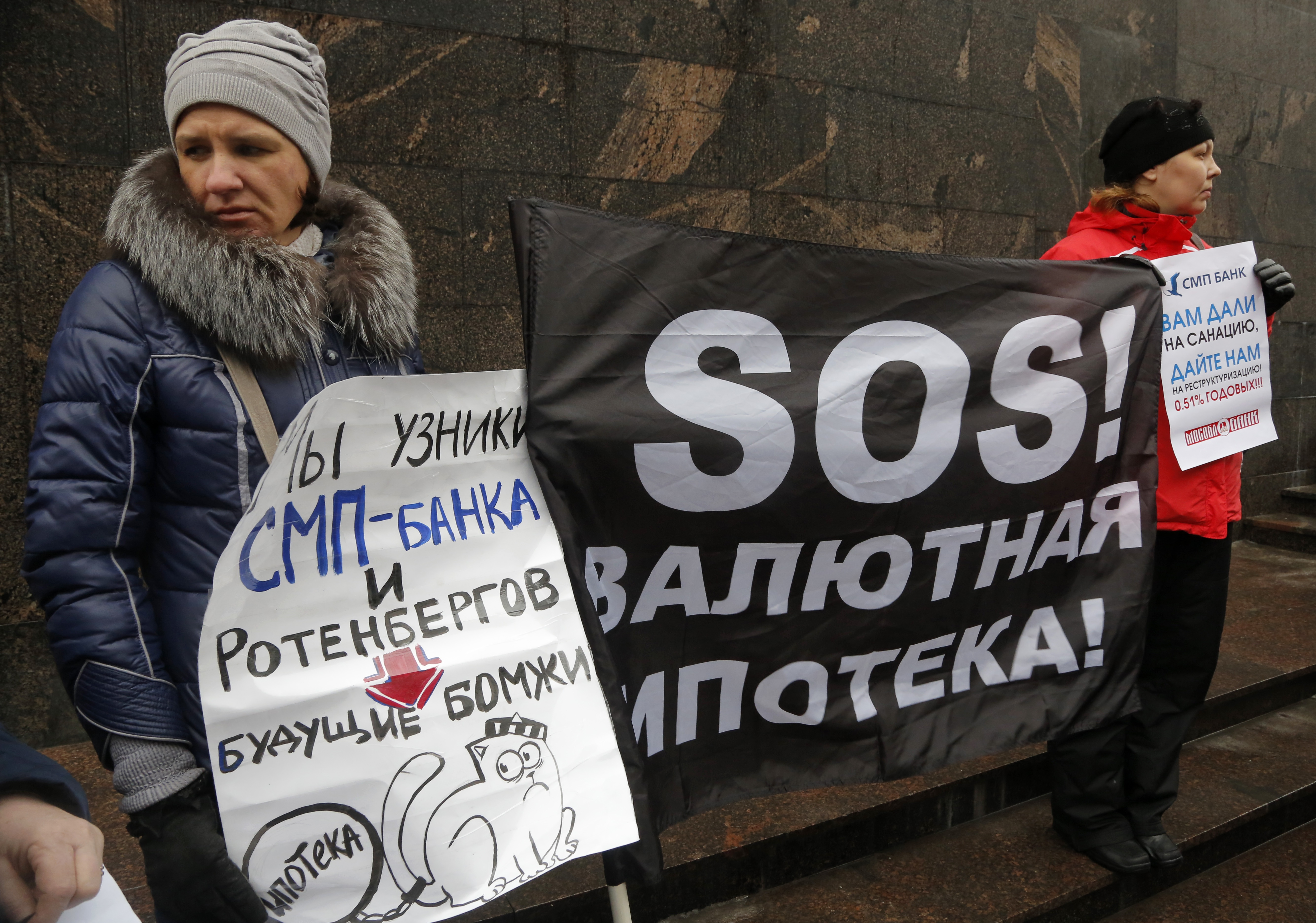 FILE - Hard-currency mortgage holders take part in a protest in front of a bank in St. Petersburg, Russia, Jan. 28, 2016.