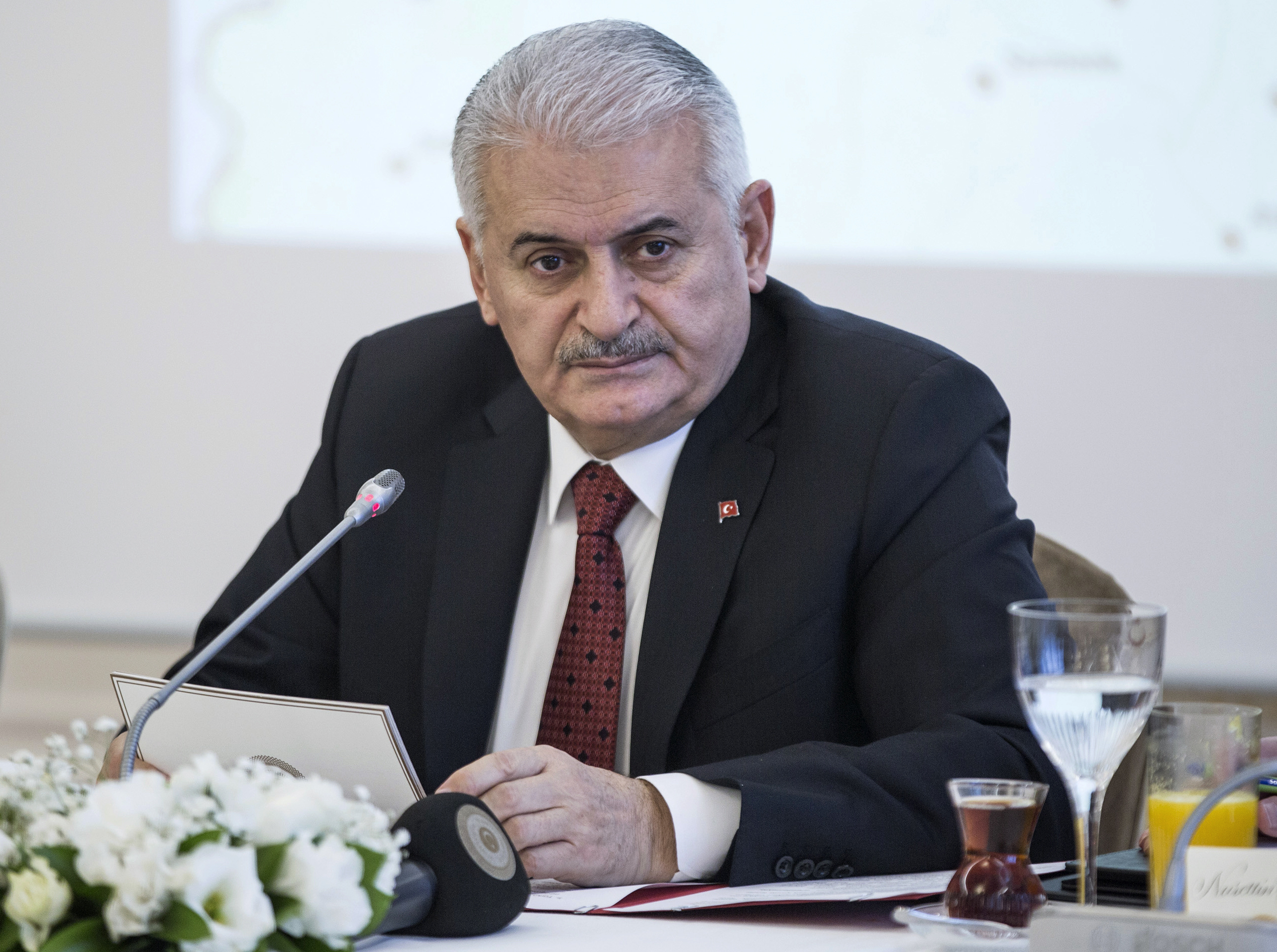 Turkish Prime Minister Binali Yildirim listens during a meeting with journalists in Istanbul, Jan. 21, 2018.